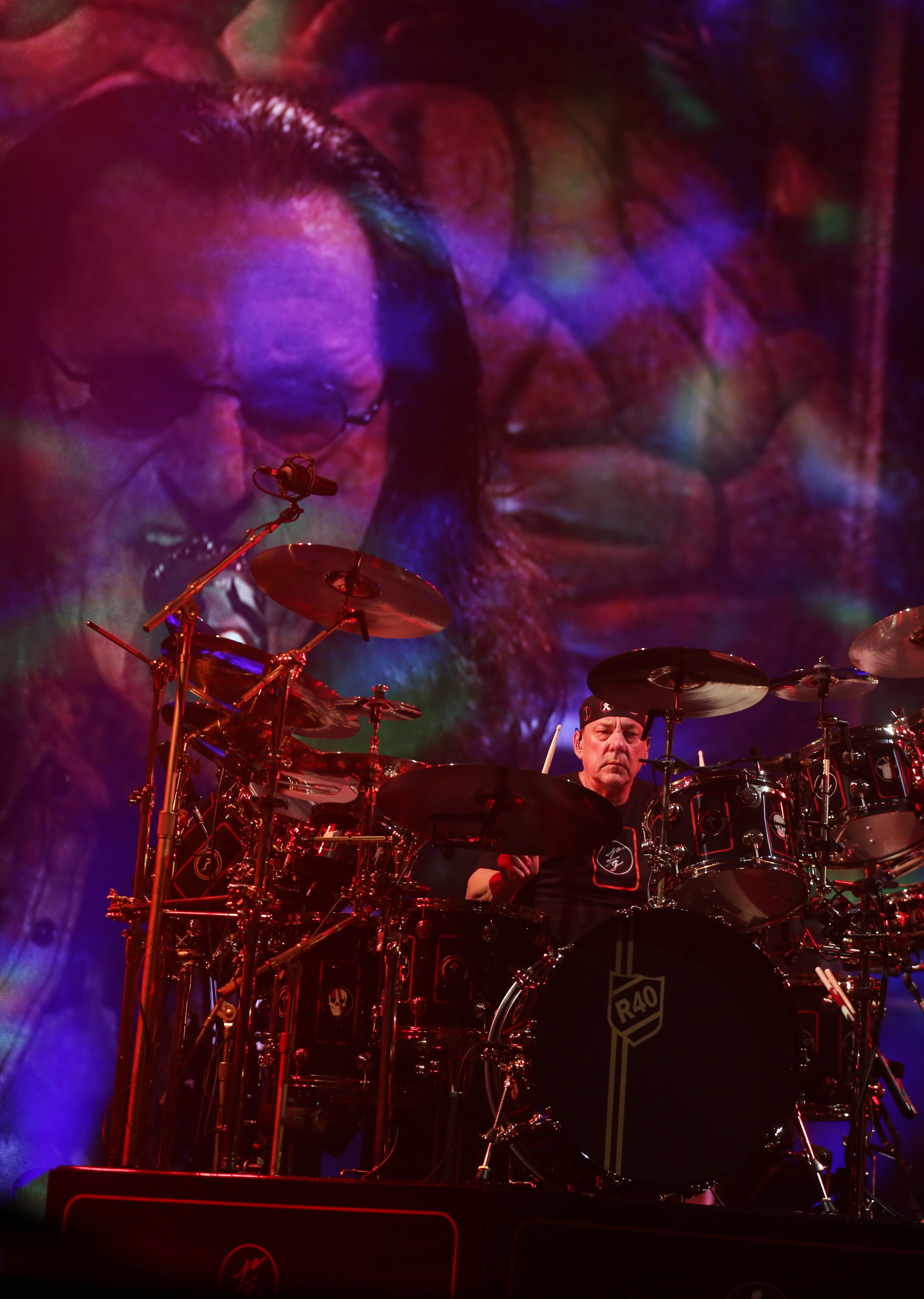 Rush played to a sold-out crowd at the First Niagara Center Wednesday as part of their R40 Tour. Neil Peart is on drums. Geddy Lee is on the screen behind him. See concert gallery at BuffaloNews.com.