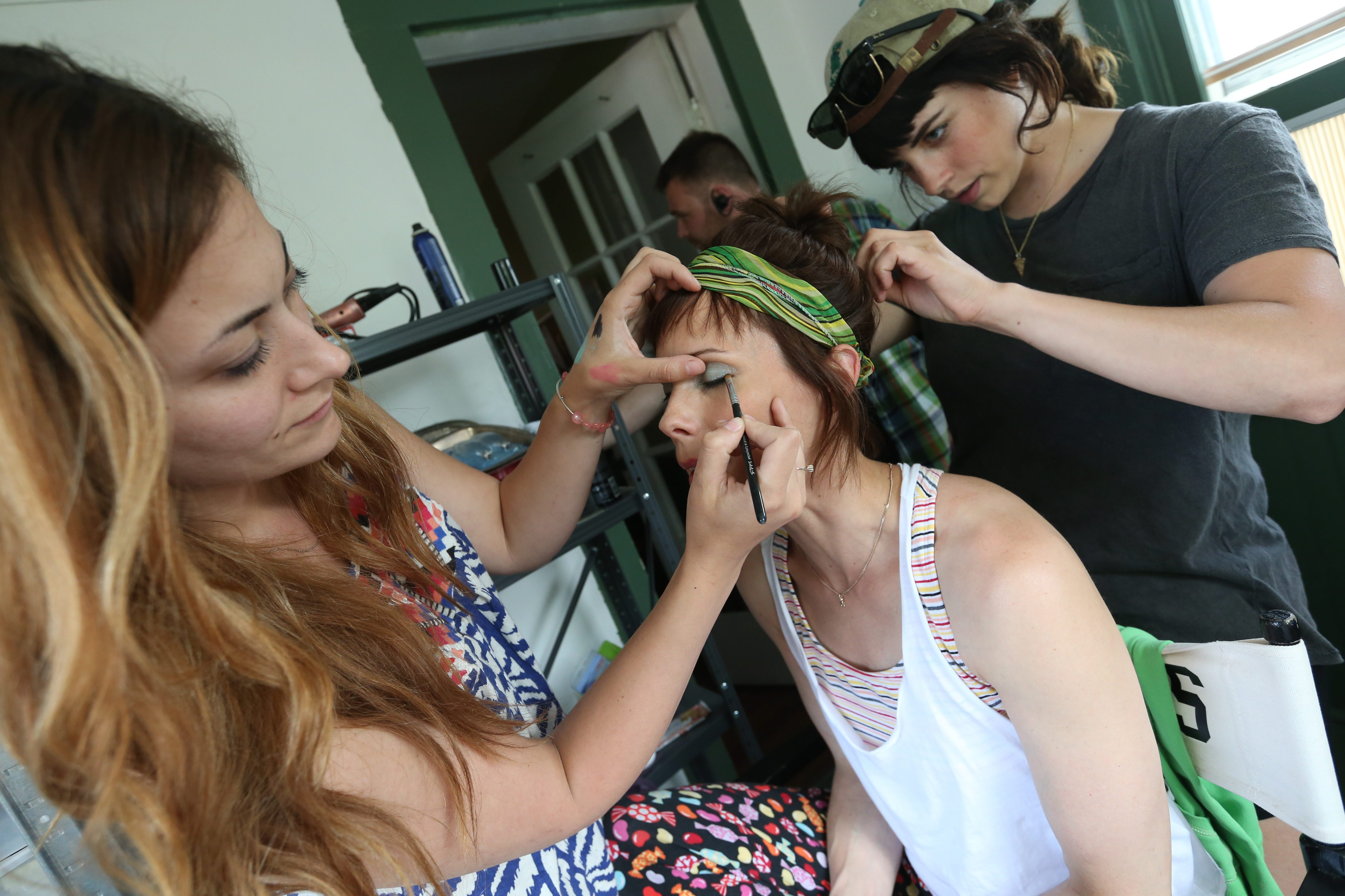 """Wilson get's her hair and makeup changed for the next scene.  Megan Norris left does makeup, while Casandra Lyons works on hair. The indie film """"Trew Calling"""" is wrapping up filming in Buffalo this week.  They're filming scenes at Trew's home played by Orchard Park native Tracey B. Wilson with costar Kevin Sizemore who plays """"I Am"""",  who is the Almighty, Thursday, June 18, 2015.  Wardrobe crew Hillary Kollar and Allison Pieroni prepare Wilson's clothes for the next scene.  The house on Knox Avenue in North Buffalo is an airbnb that was rented for the month.  The filming is happening with the support of the Buffalo Niagara Film Office.  NDstudios is doing all the production work.  """"Trew Calling"""" is a dramedy which is due to release newt summer.  (Sharon Cantillon/Buffalo News)"""