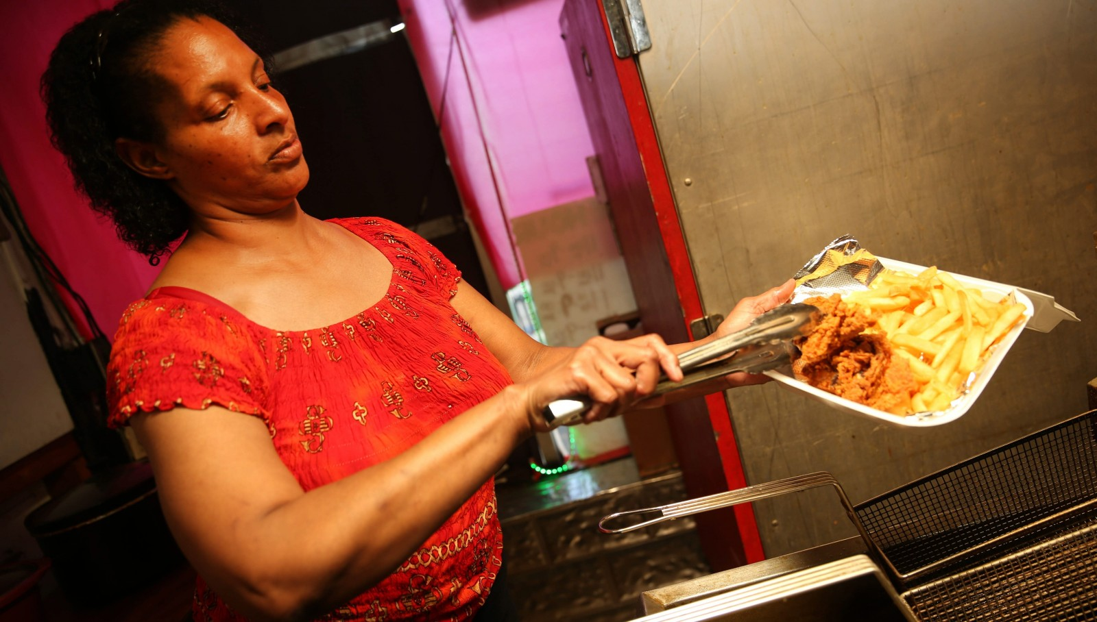 Owner Annette Harper puts together the thigh box - two chicken thighs and french fries - at Nette's Fried Chicken.