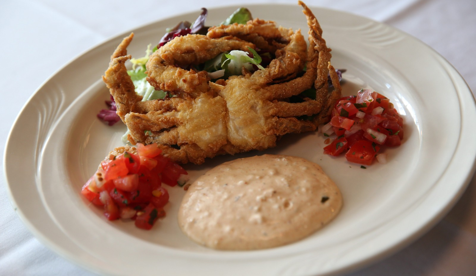 Hutch's crispy soft-shelled crab with a Cajun remoulade, market salad and pico de gallo. (Sharon Cantillon/Buffalo News file photo)