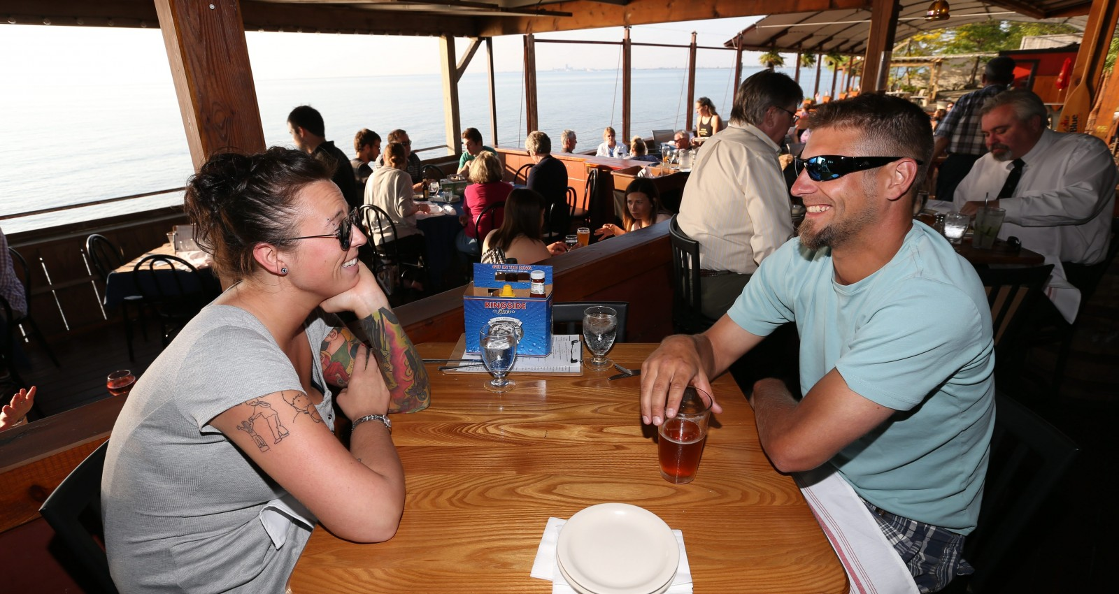 Emily Harris of Blasdell and Mike Matesic of Lakeview hang out on the patio at the Public House on the Lake in Hamburg. (Sharon Cantillon/Buffalo News)