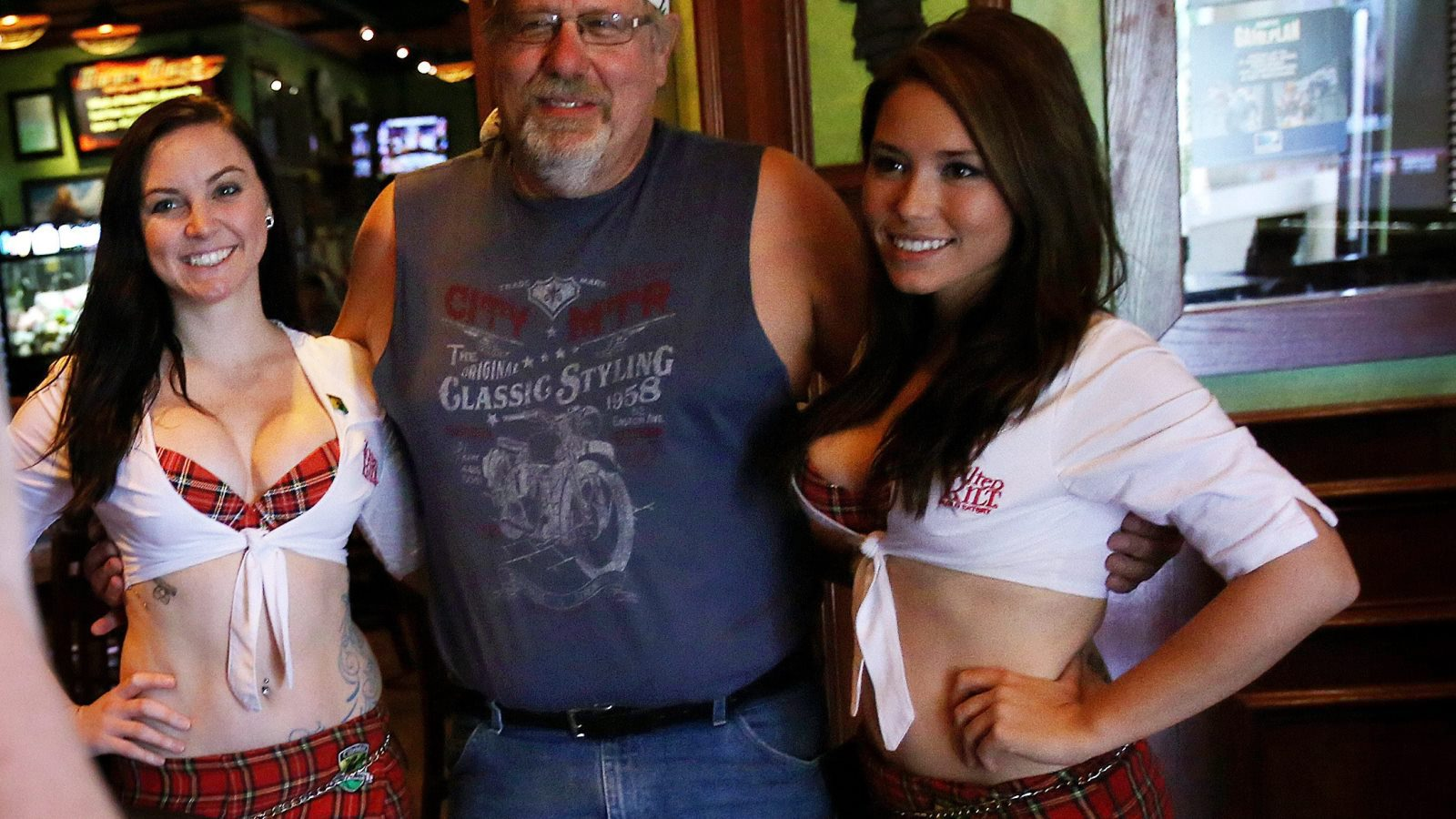 Customers getting photos taken with Tilted Kilt employees is commonplace.