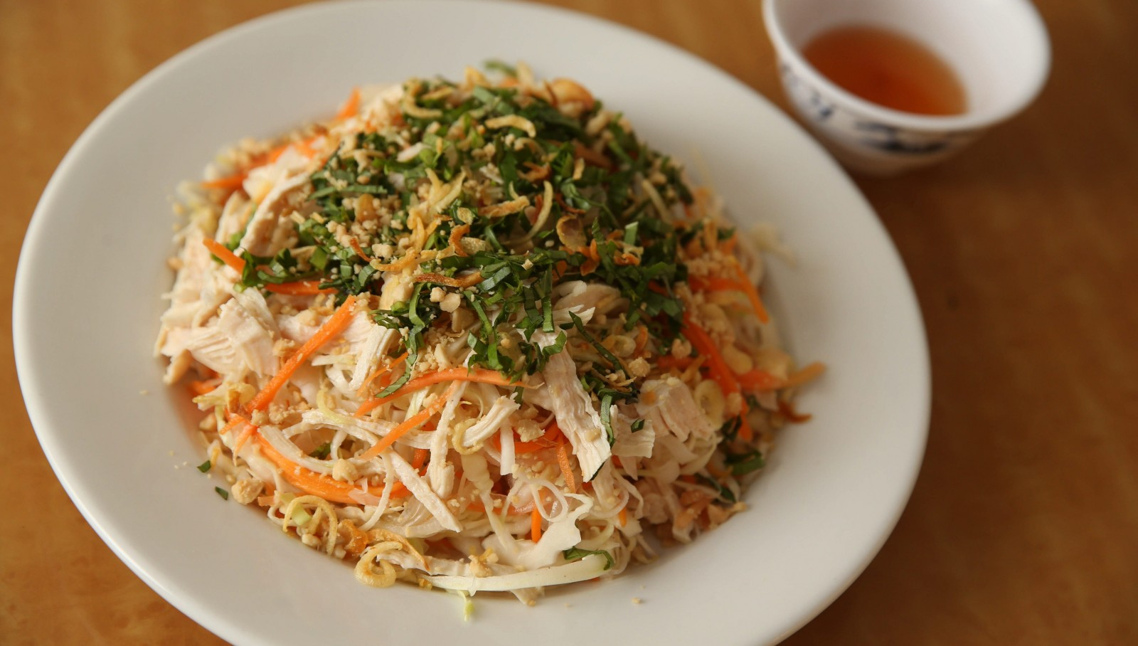 The Goi Ga at Pho Dollar is Vietnamese chicken salad with crispy raw vegetables in a tangy sauce of lime juice and vinegar. (Sharon Cantillon/Buffalo News)