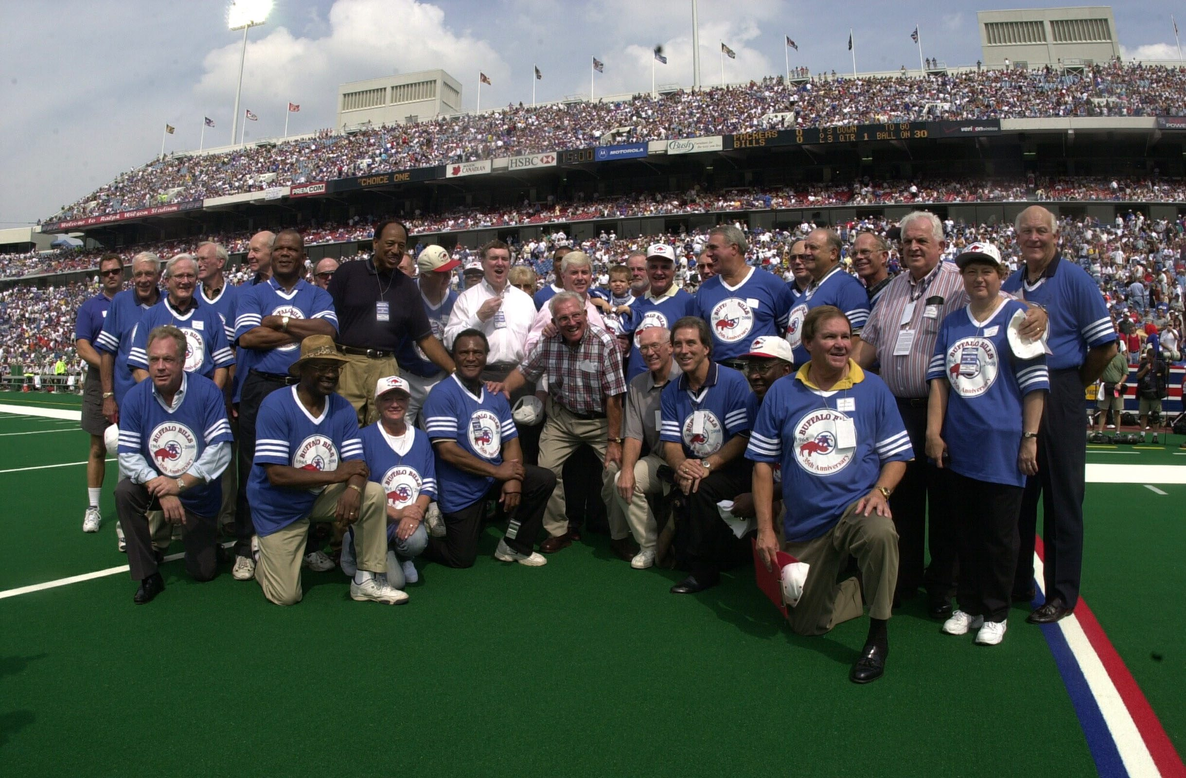 Lou Saban was front and center in 2000 when members of the 1965 Bills AFL Championship team were honored at Ralph Wilson Stadium. (Harry Scull Jr. / Buffalo News file photo