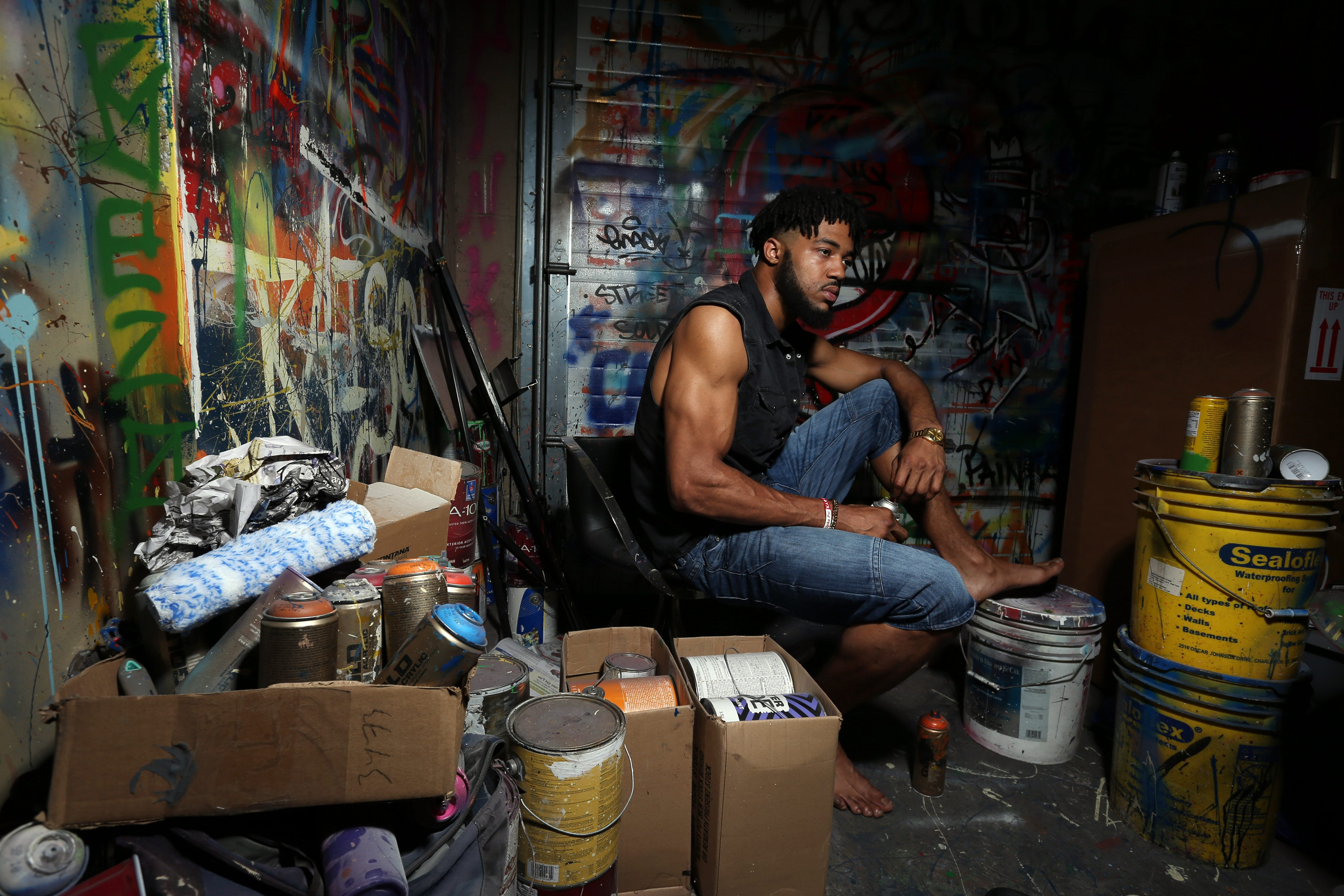 "Aaron Maybin, photographed in his Baltimore studio, is proud that he made enough money during four years in the NFL to retire his folks to South Carolina. ""My family wanted out, and through football, they got out."""