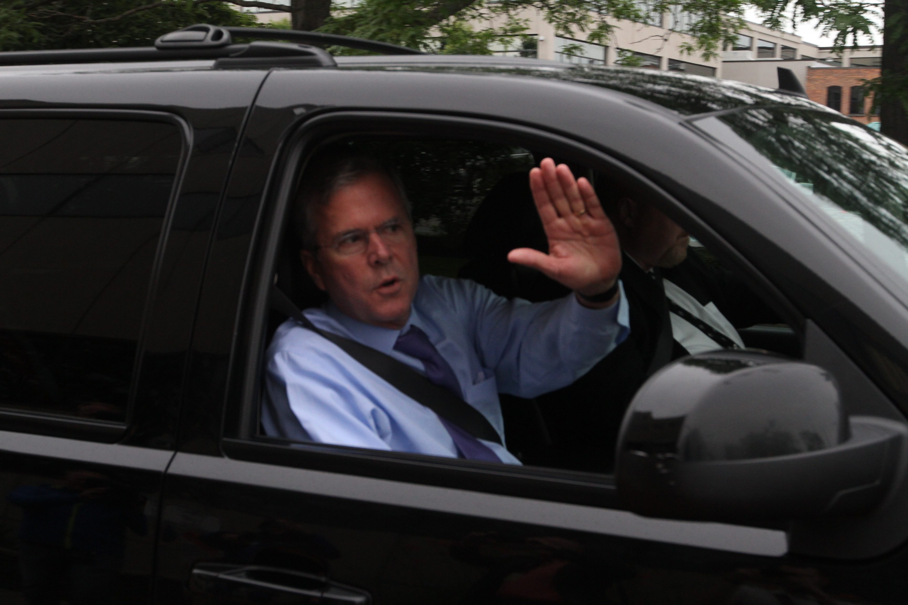 Words were few by GOP candidate Jeb Bush and supporters as he departs Atrium @ Rich's after fundraising breakfast.