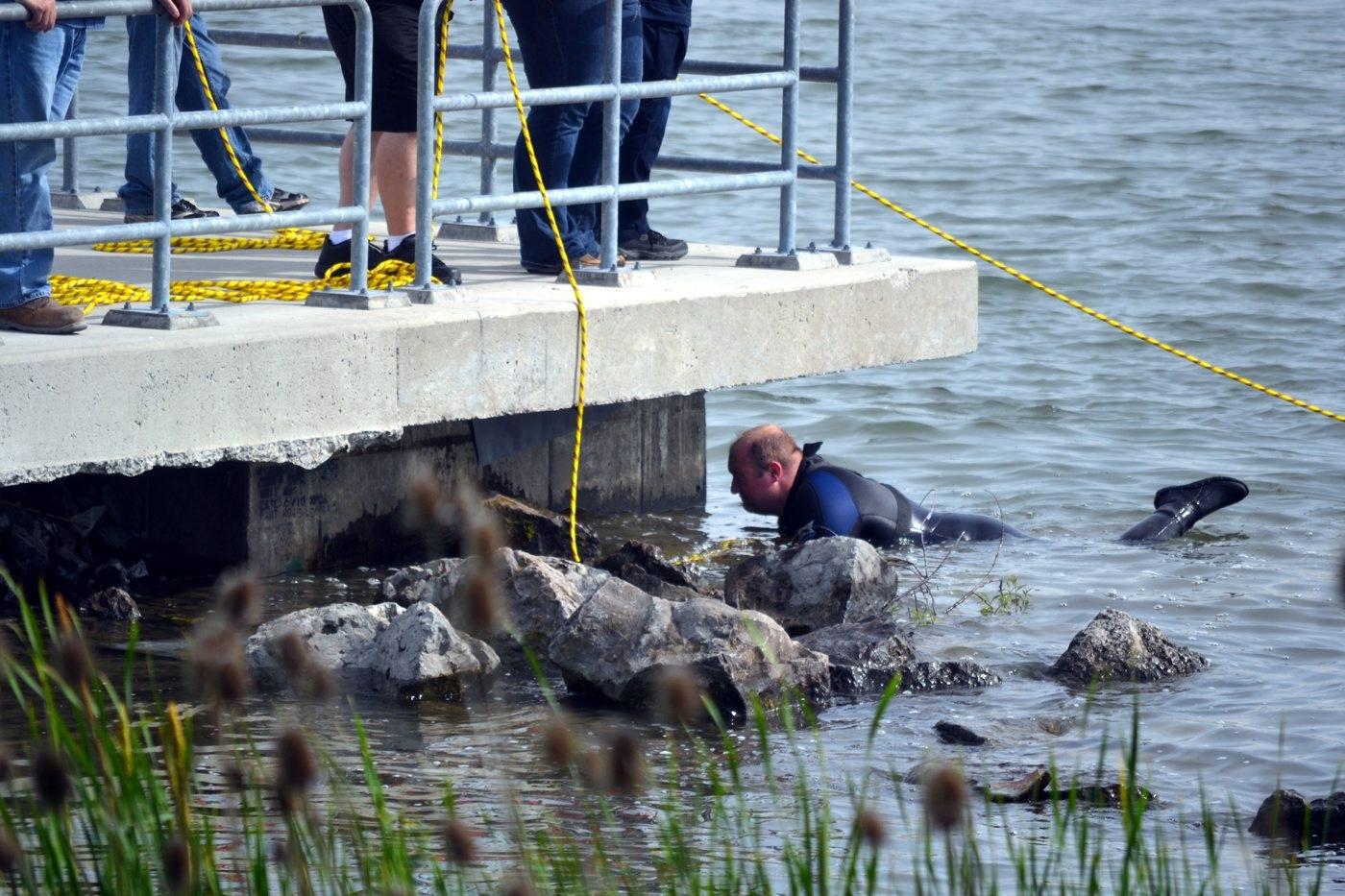 A dive team searches Gratwick Park in North Tonawanda for human remains June 29. (Larry Kensinger/Contributor)