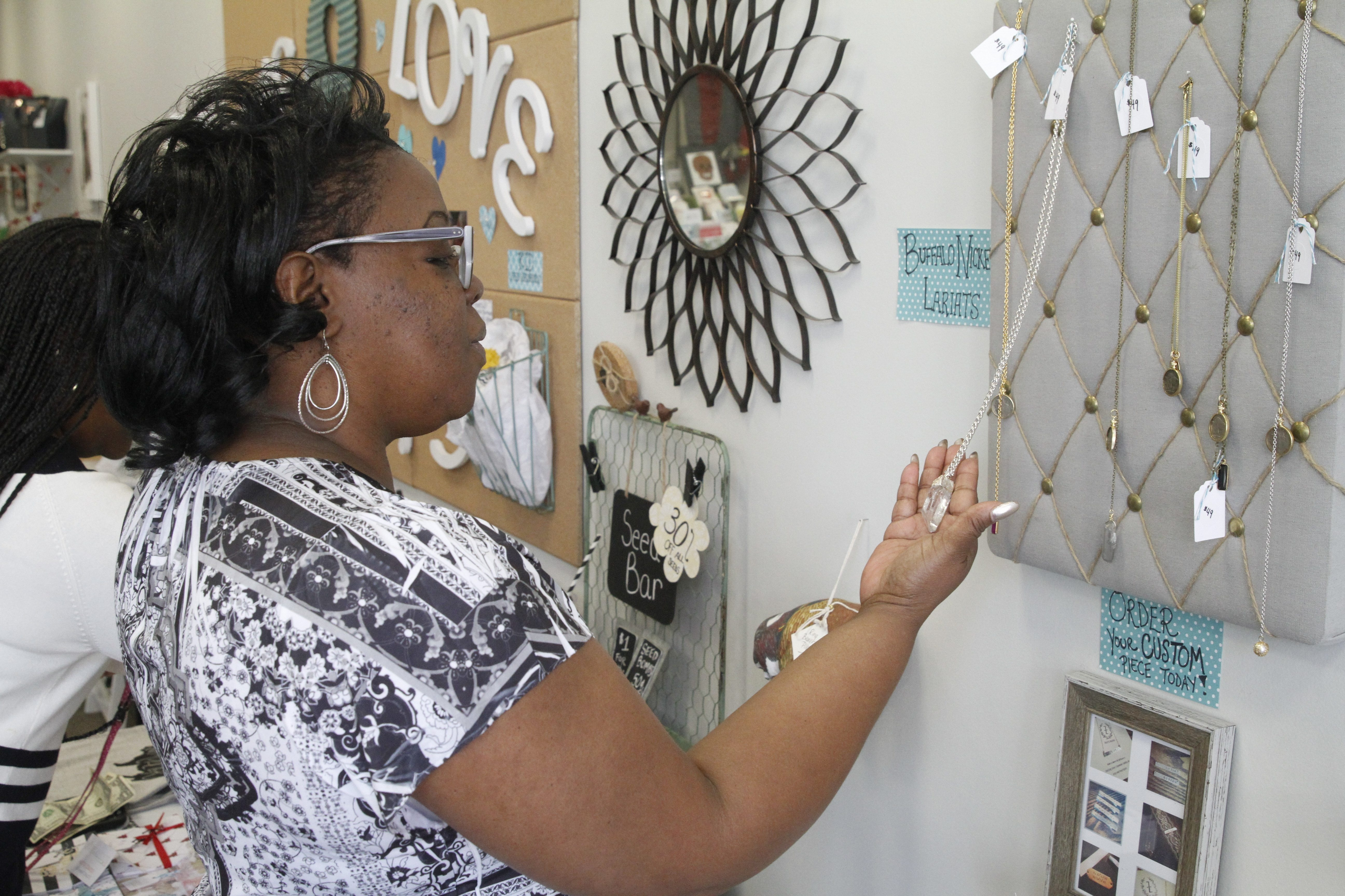 Danita Anderson shops during her lunch break at Life & Love Events, 653 Main St., one of five vendors taking part in Queen City Pop-Up. The program provides free space for retailers to foster business growth and enhance shopping opportunities downtown.