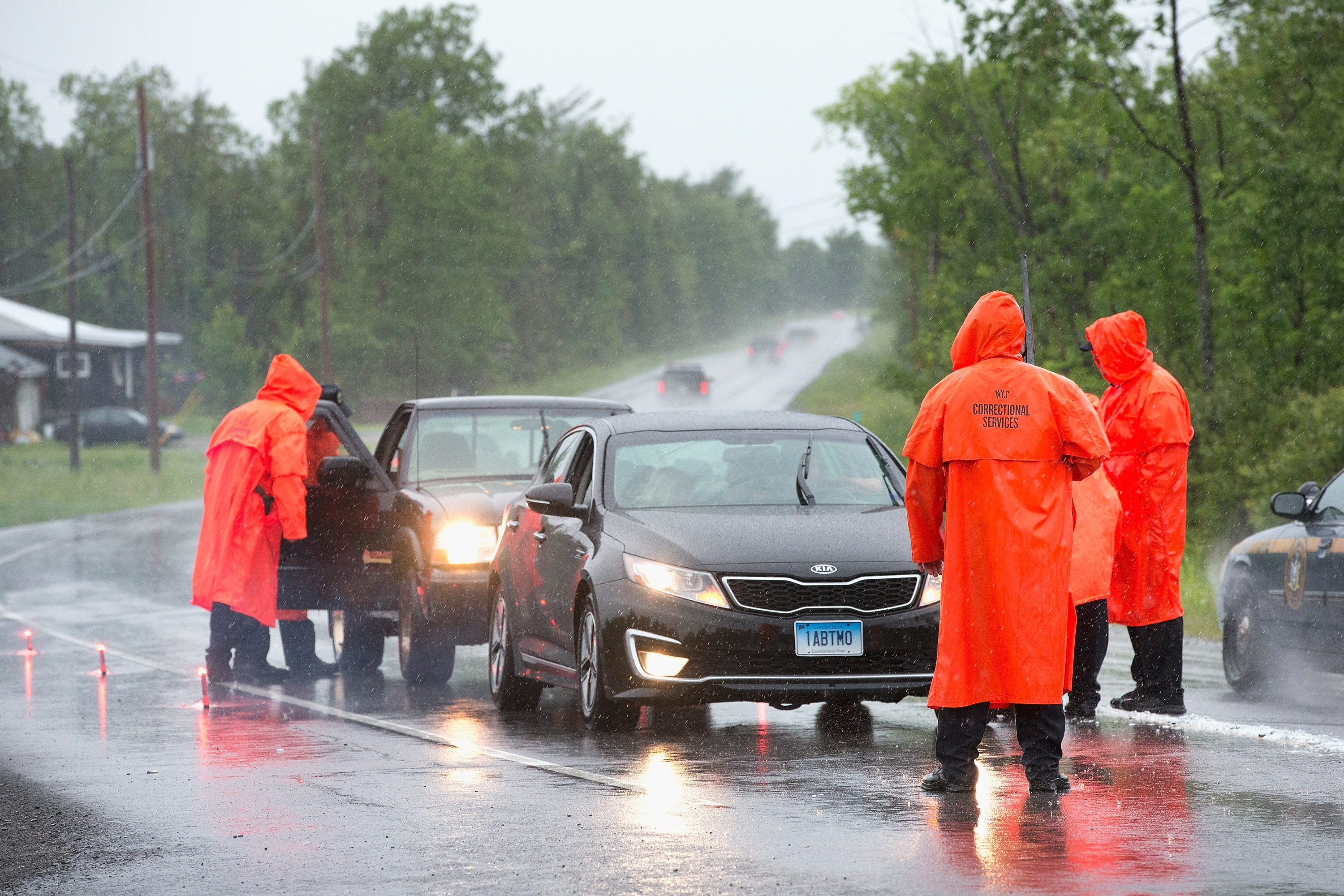 Correction officers search vehicles at a roadblock along Highway 30 near a wooded area where they believe escaped convict David Sweat may be hiding on June 28, 2015 near Malone, New York.  (Getty Images)