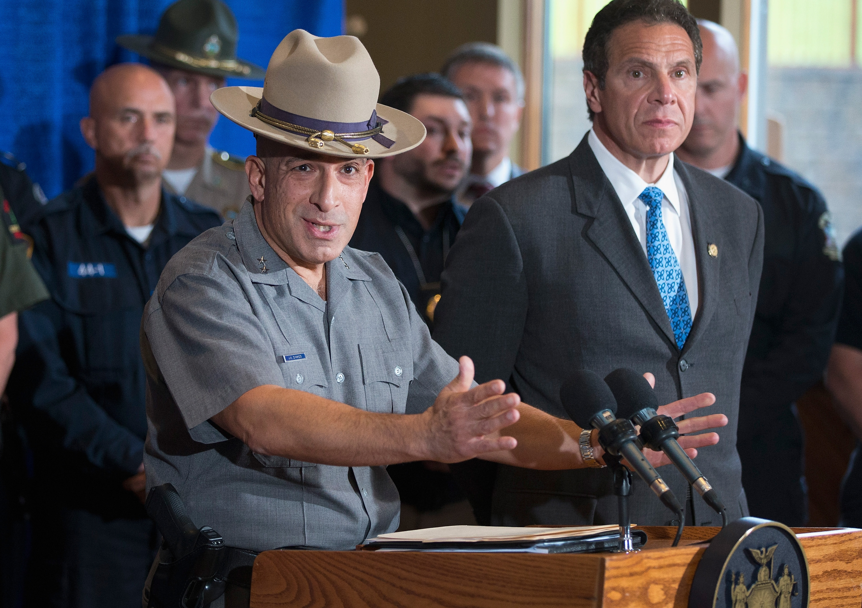 Flanked by New York Gov. Andrew Cuomo, New York State Police Supt. Joseph DAmico speaks to the media about the capture of convicted murderer David Sweat on June 28, 2015 in Malone. (Getty Images)