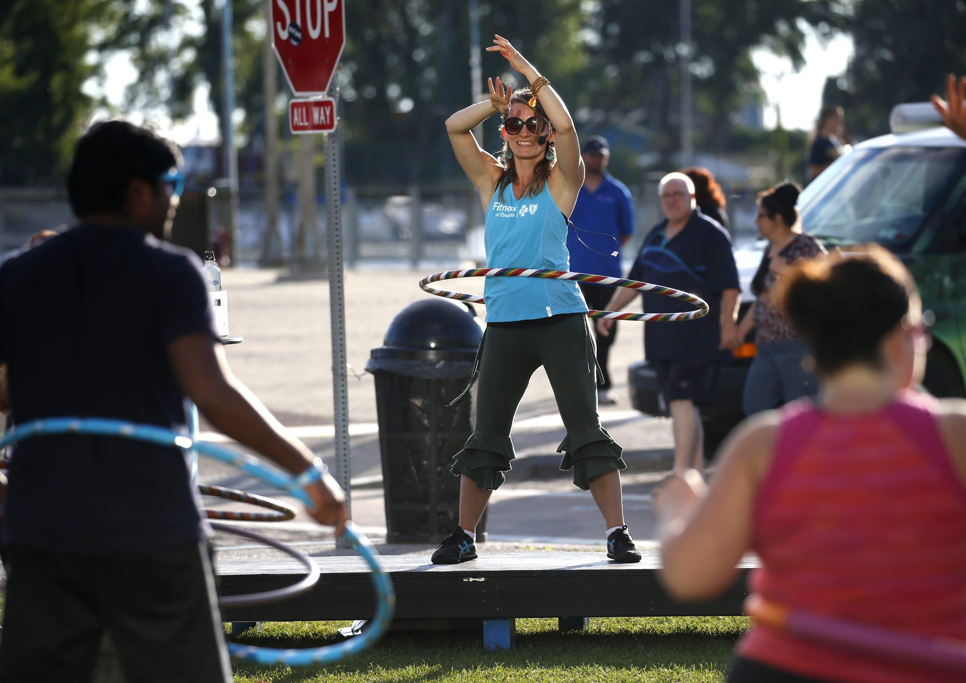 Kristin Damstetter leads a hula hoop class at Canalside on June 23.  (Robert Kirkham/Buffalo News)