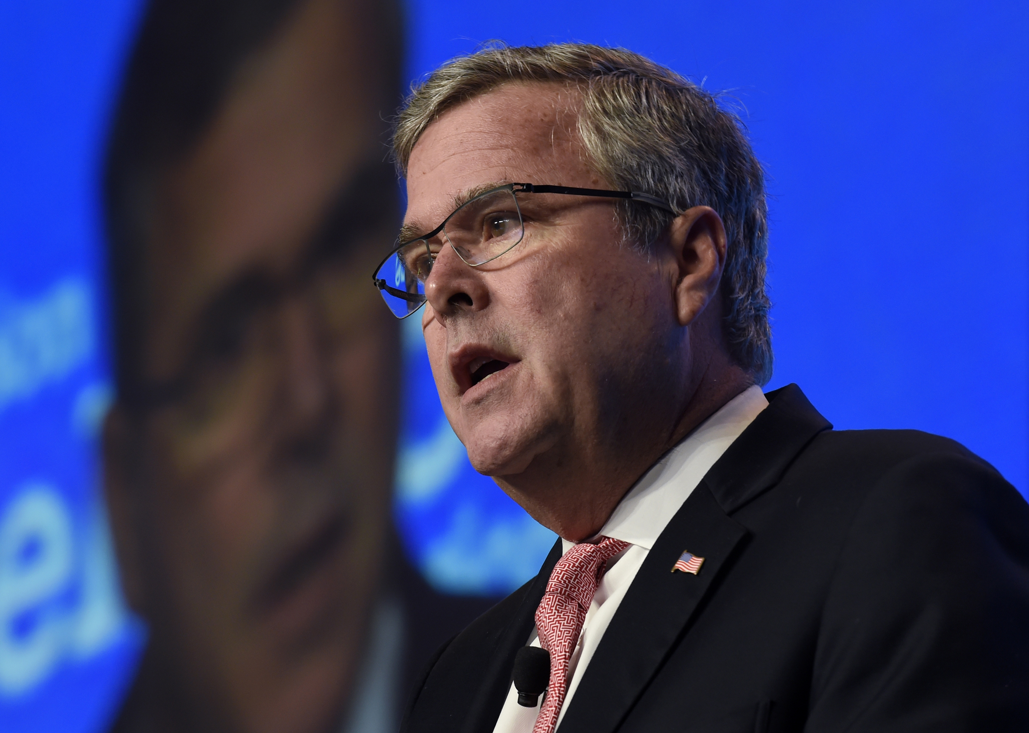 FILE - In this Nov. 20, 2014 file photo, former Florida Gov. Jeb Bush speaks in Washington. Thereís a whole year of campaigning, positioning and politicking to go before the next campaign for president kicks off with the Iowa Caucus in early 2016. Hereís a look at 10 things to look out for next year that might tell us something about how that campaign to come (which is really already underway) may shake out.  (AP Photo/Susan Walsh, File)