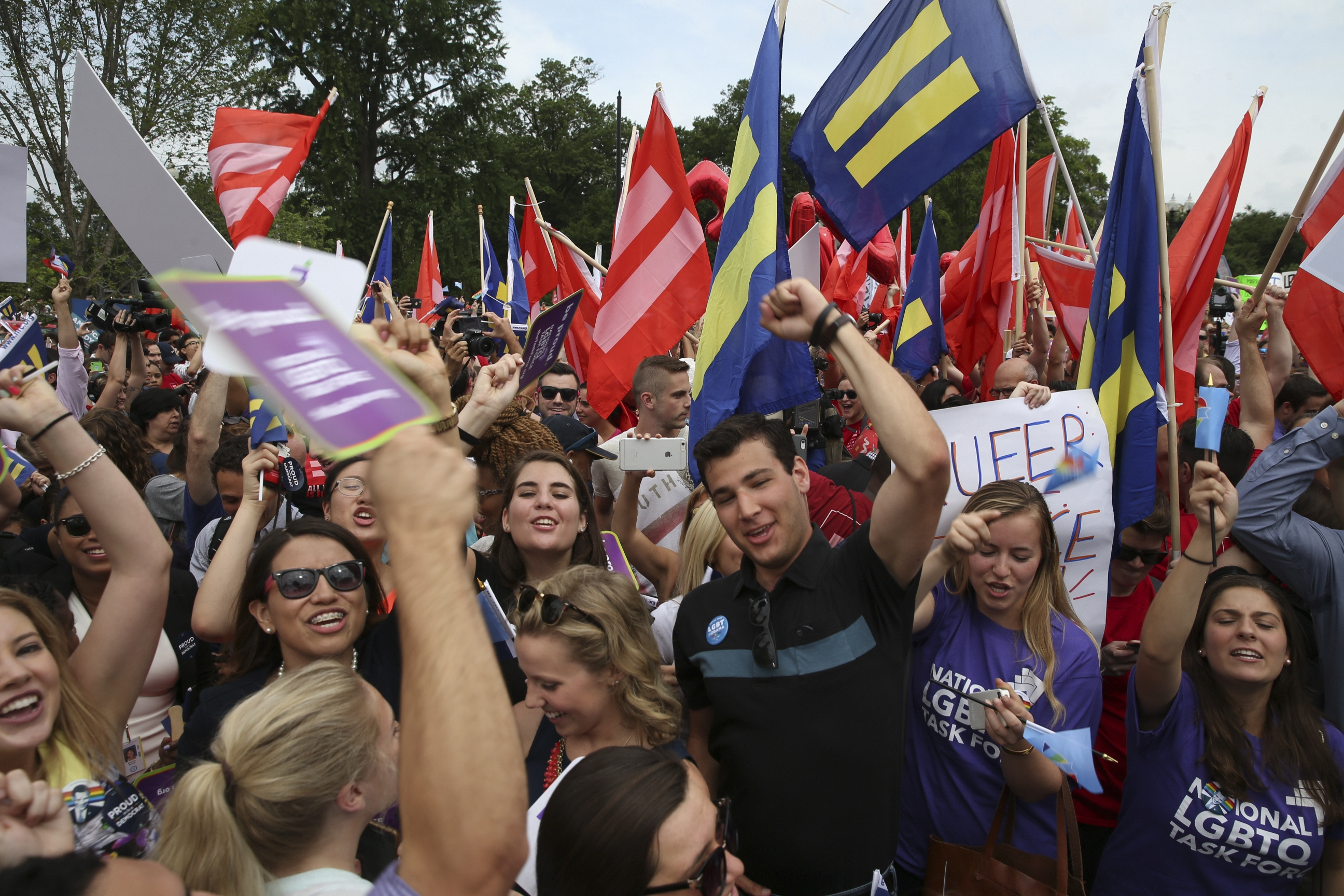 People celebrate outside the U.S. Supreme Court following the announcement of the ruling on the same-sex marriage case, in Washington, June 26, 2015. (New York Times)