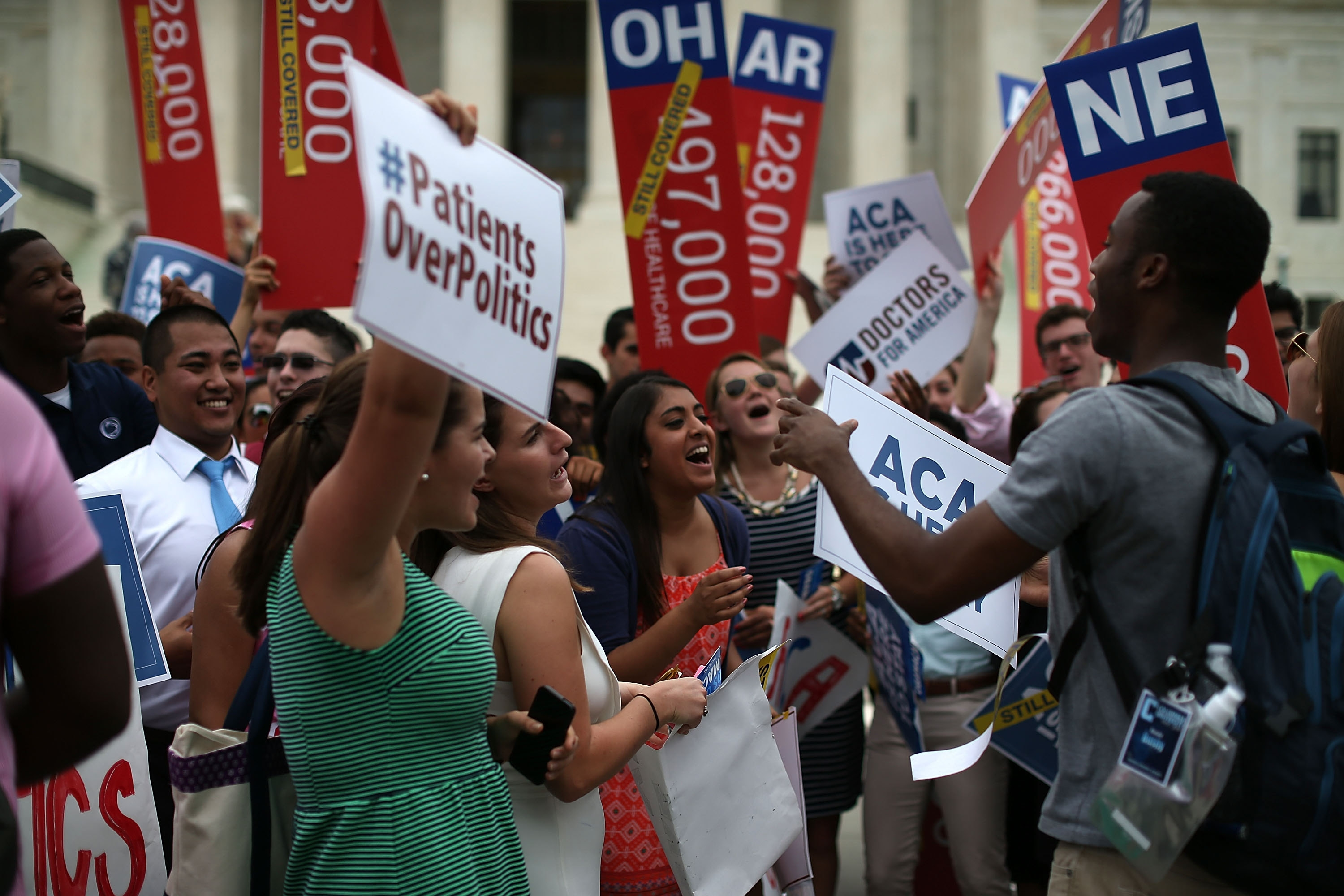 Supporters of the Affordable Care Act celebrate in front of the U.S. Supreme Court. (Getty Images)