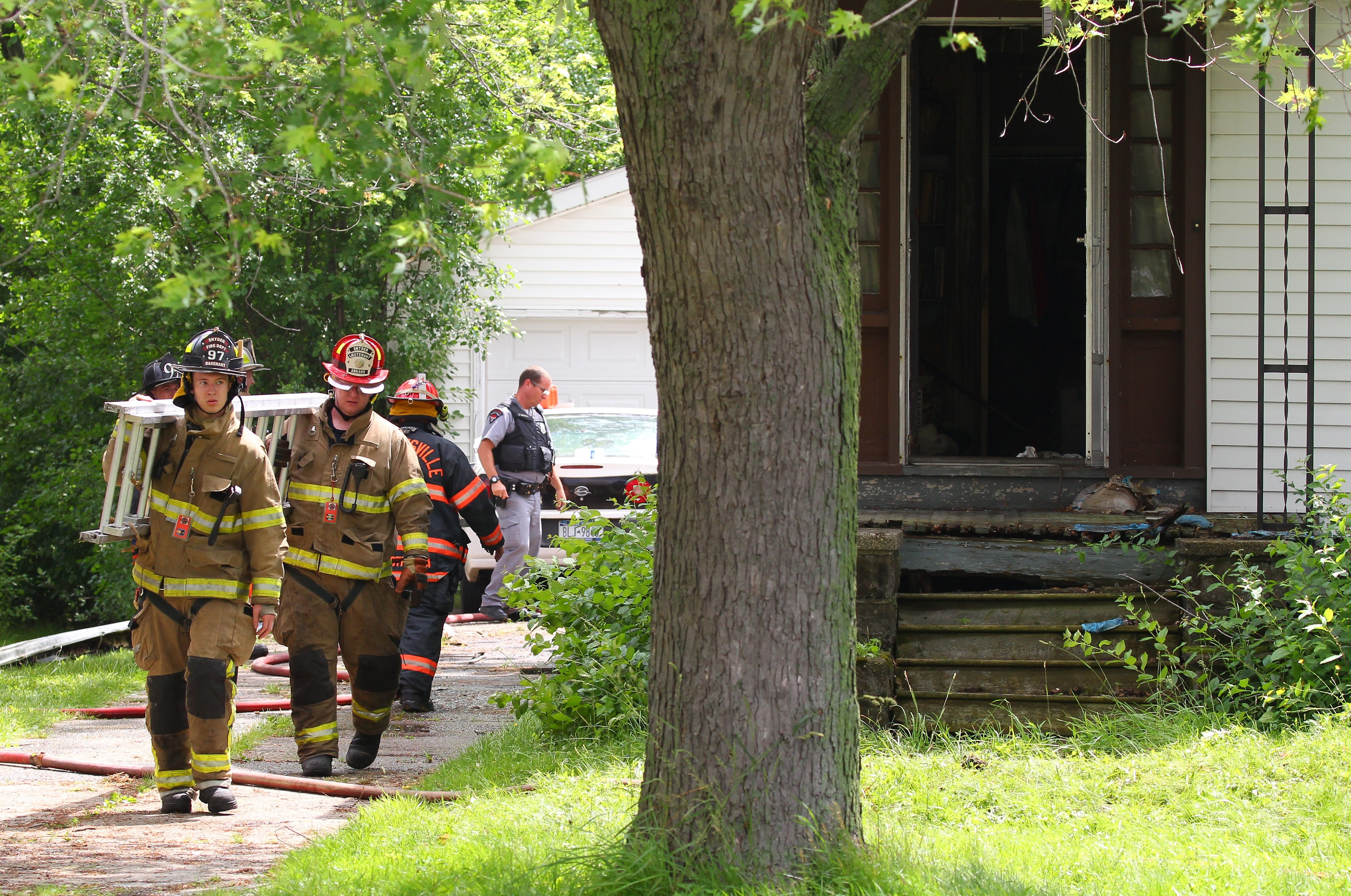 Crews work the scene of a house fire on Eggert Rd in Amherst Tuesday, June 23, 2015.    (Mark Mulville/Buffalo News)
