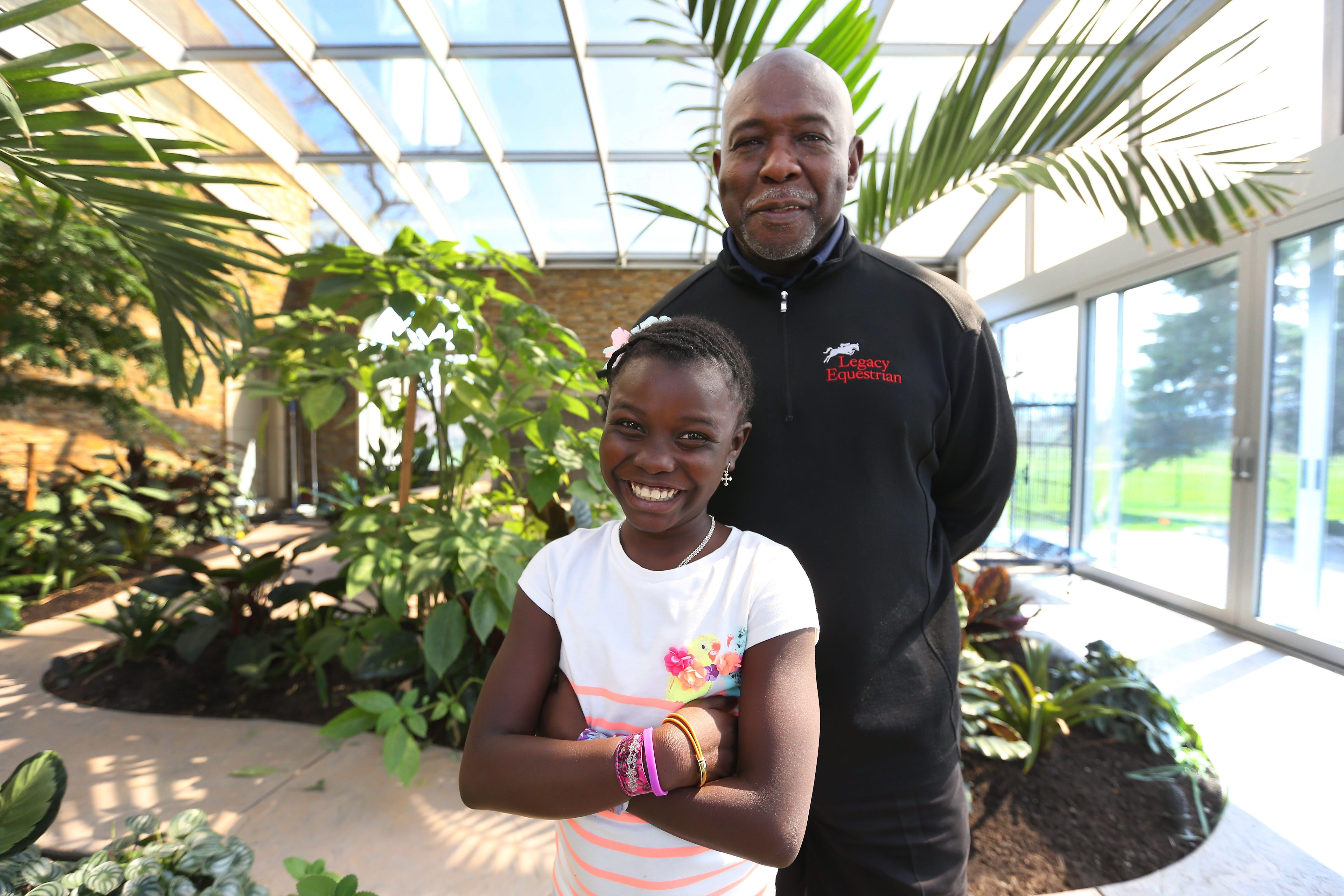 Dr. Greg Daniel and his adopted daughter, Chekina, at their home in Clarence. After a lengthy and difficult process to adopt Chekina from the monastery where she lived after her parents were killed, she now lives with Daniel in Western New York.