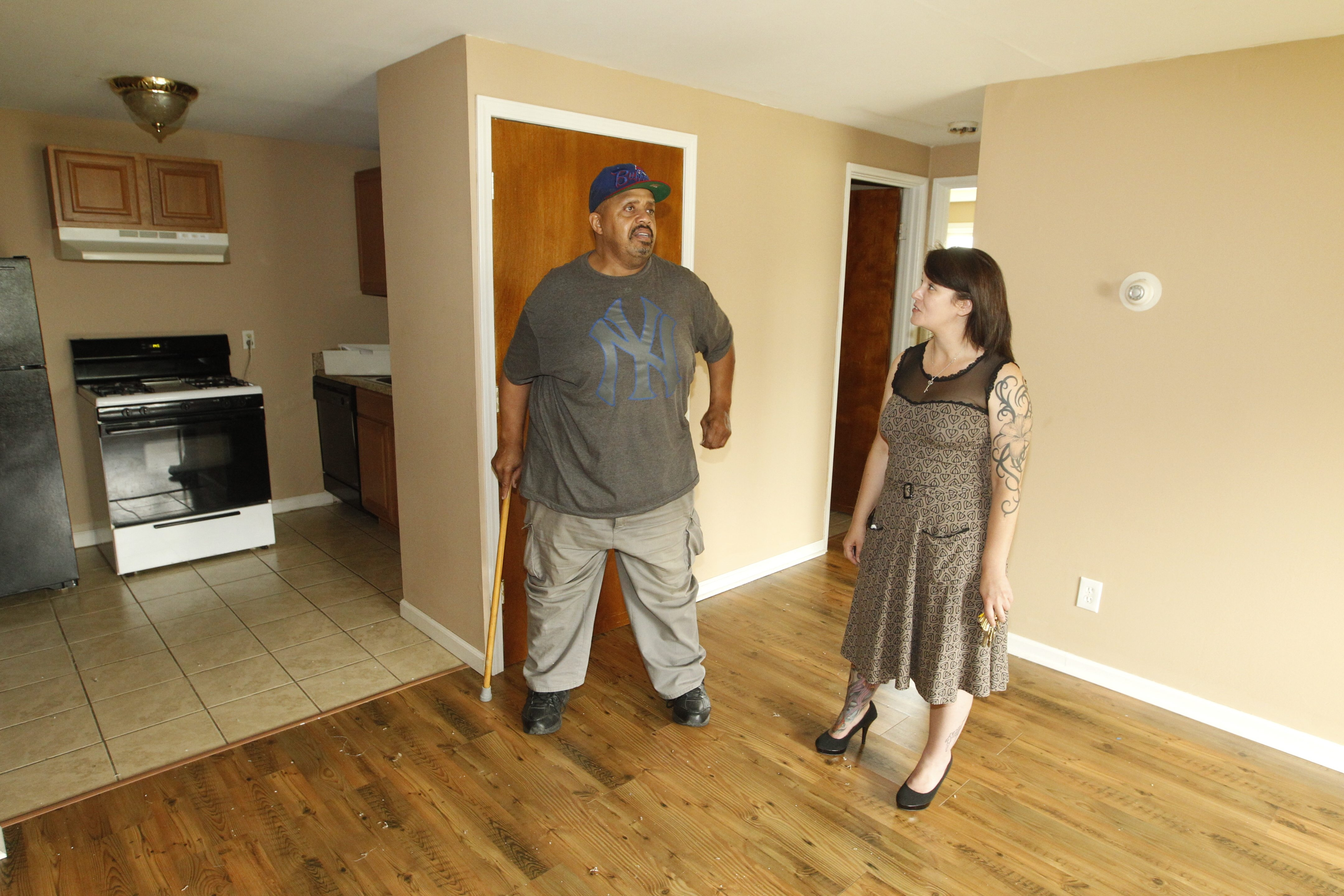 Valerie McNair shows a two bedroom apartment to Samuel Nix at Bellreng Apartments  in Niagara Falls Friday, June 19, 2015 . (John Hickey/Buffalo News)