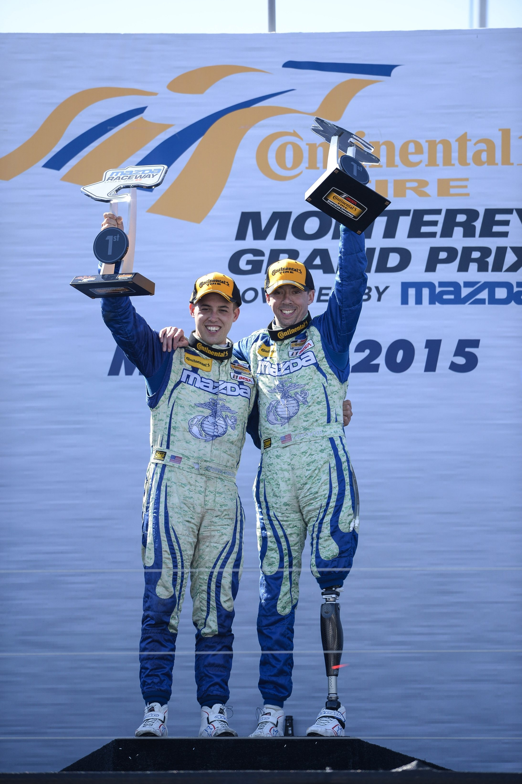 Liam Dwyer and Andrew Carbonell celebrate their victory last month at Laguna Seca.