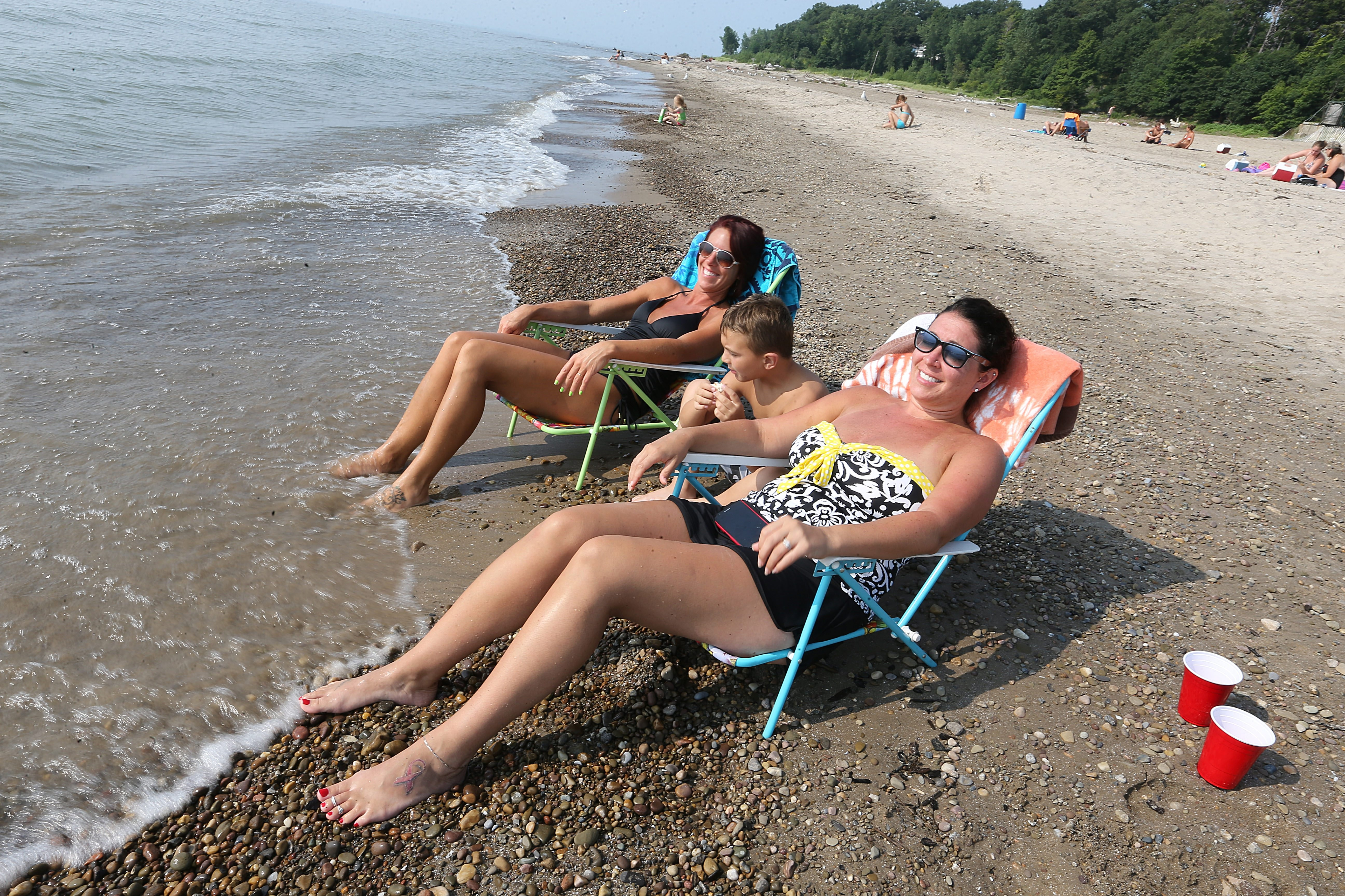 From left: Sarah Dispenza, Max Dispenza, 5, and Nicole Sortisio, all of Hamburg, enjoy the sun and surf on Bennett Beach in Evans, Friday, August 1, 2014. {Photo by Charles Lewis/Buffalo News}