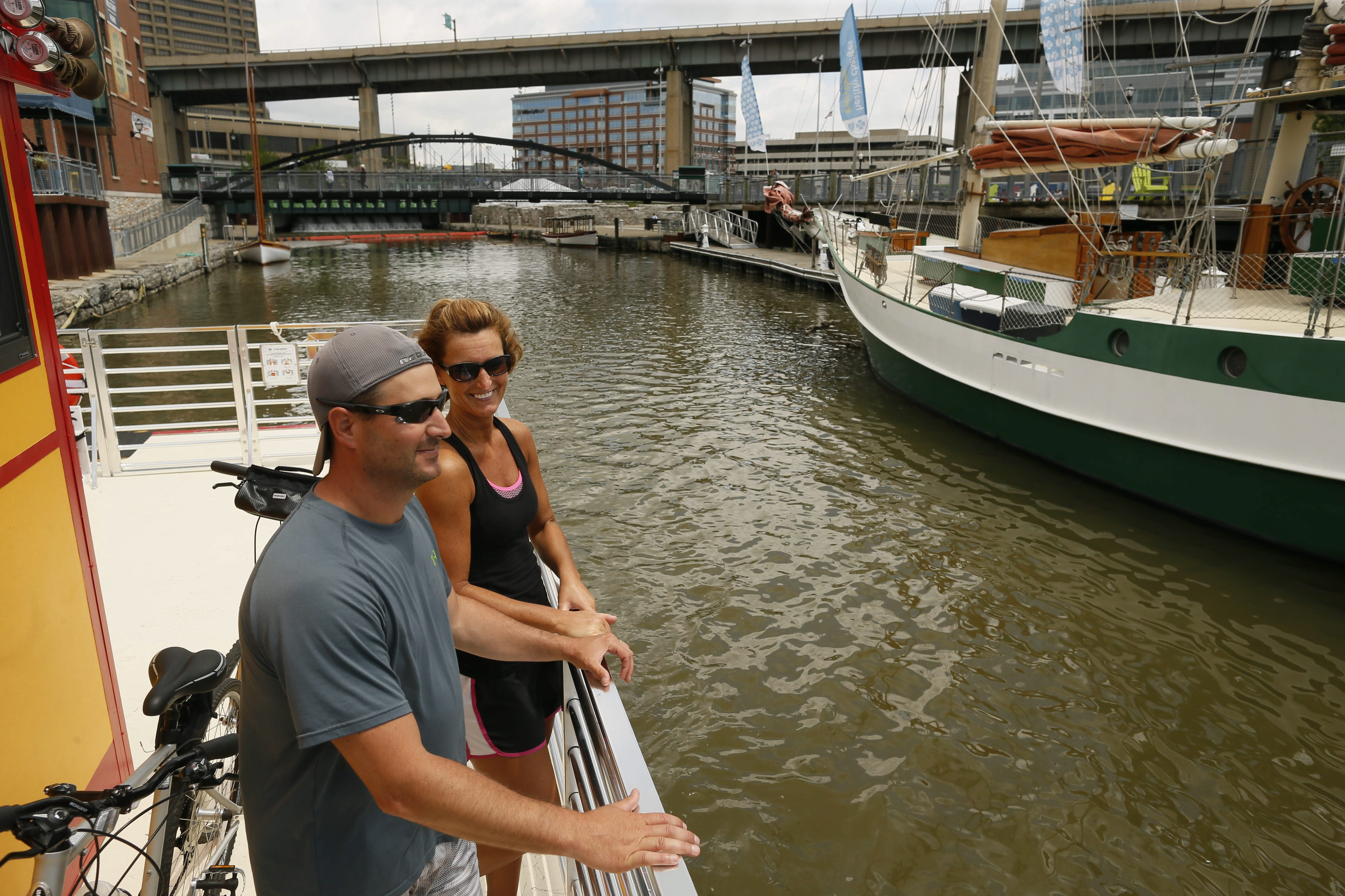 Tim and Jen Creighton ride the new bike ferry across the Buffalo River from Canalside to the Outer Harbor on Tuesday, June 16, 2015.