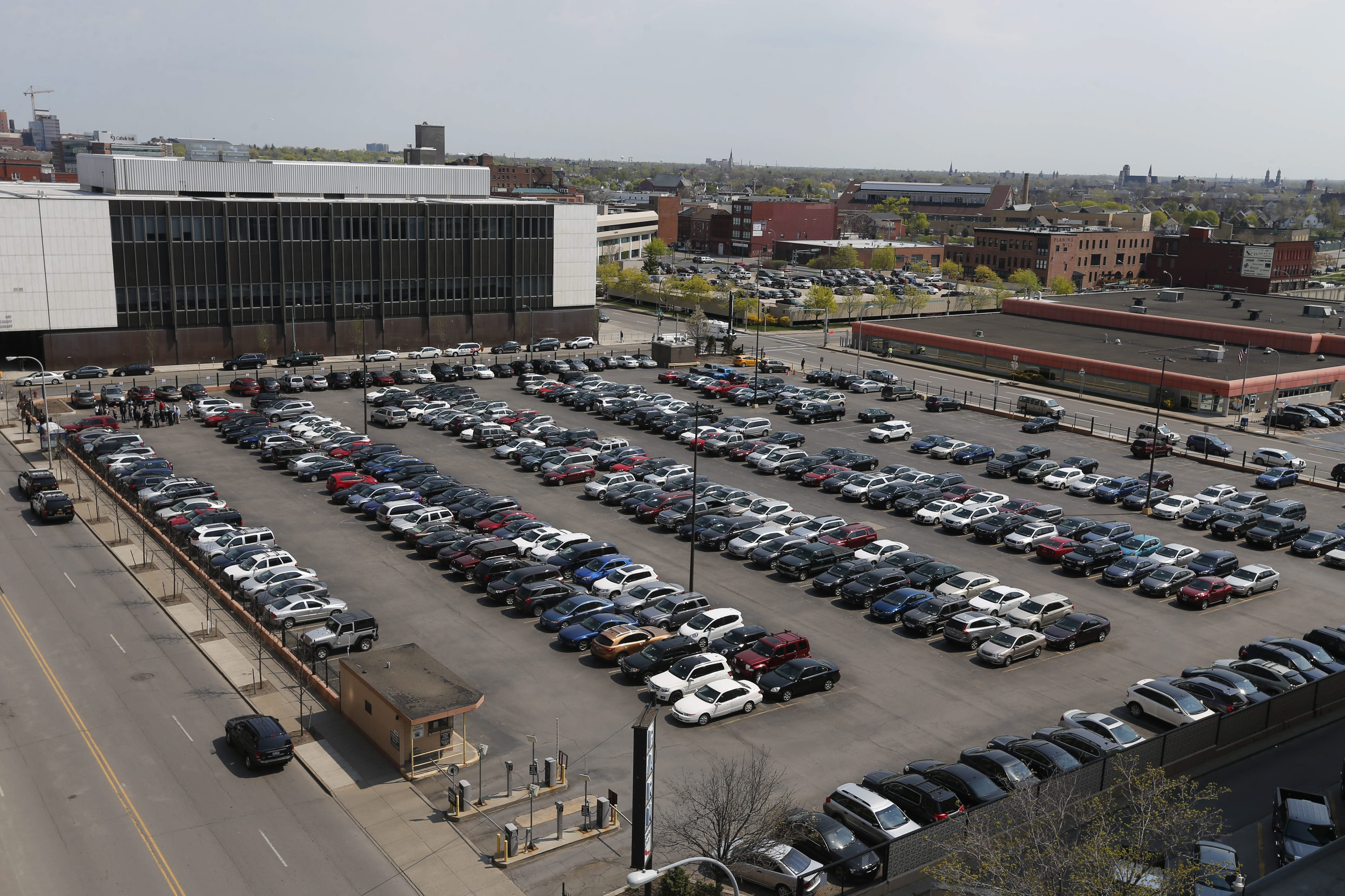 The parking lot on the 200 block of Ellicott Street where the city plans to get a grocery store, condominiums and a parking ramp on a vacant downtown parking lot at 201 Ellicott St. that will be developed.