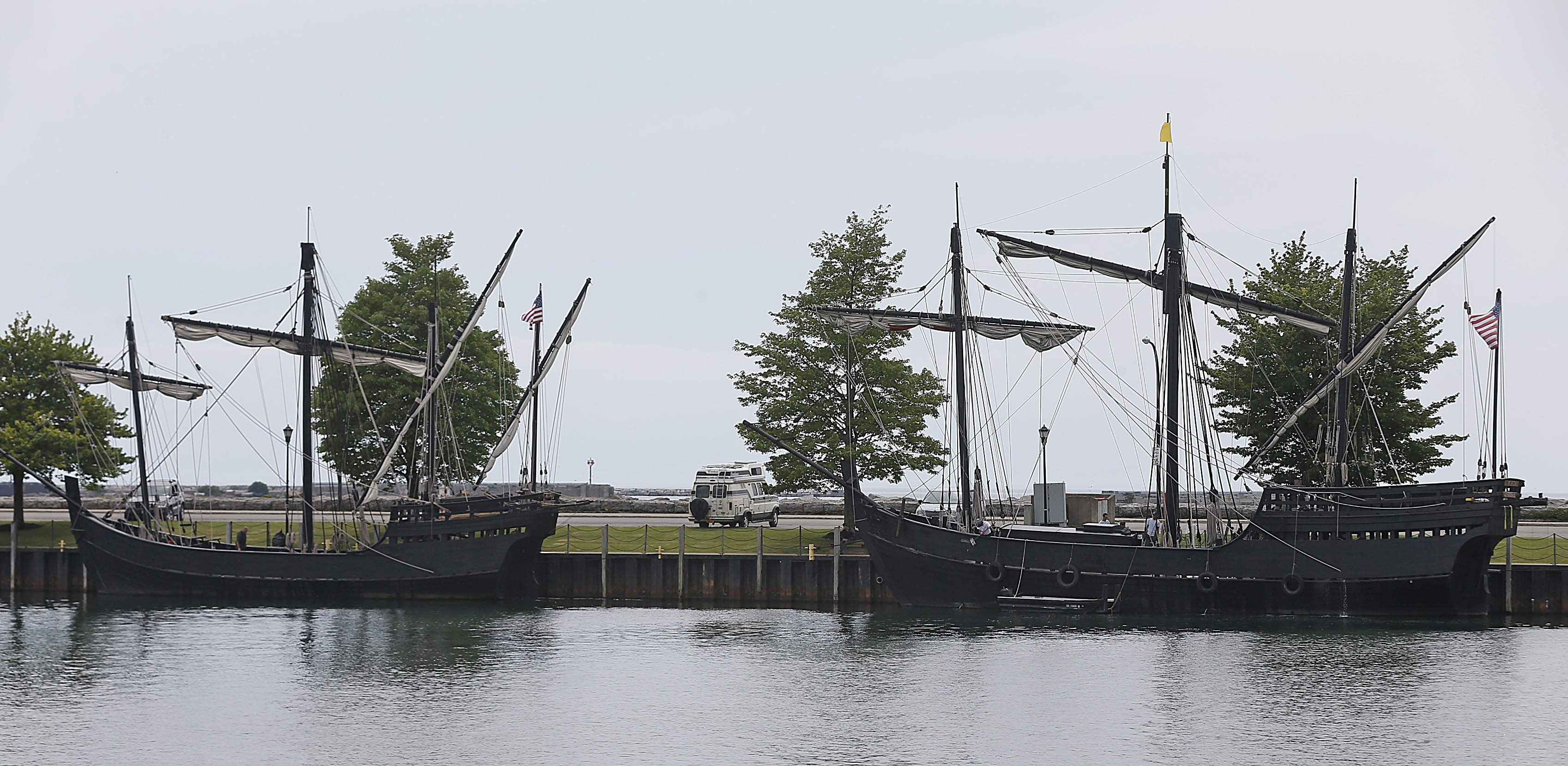 The Pinta, right, and the Nina,  two replica ships depicting the Christopher Columbus times, docked at the Erie Basin Marina after a malfunctioning lift bridge prevented their passage through Black Rock Channel. (Robert Kirkham/Buffalo News)