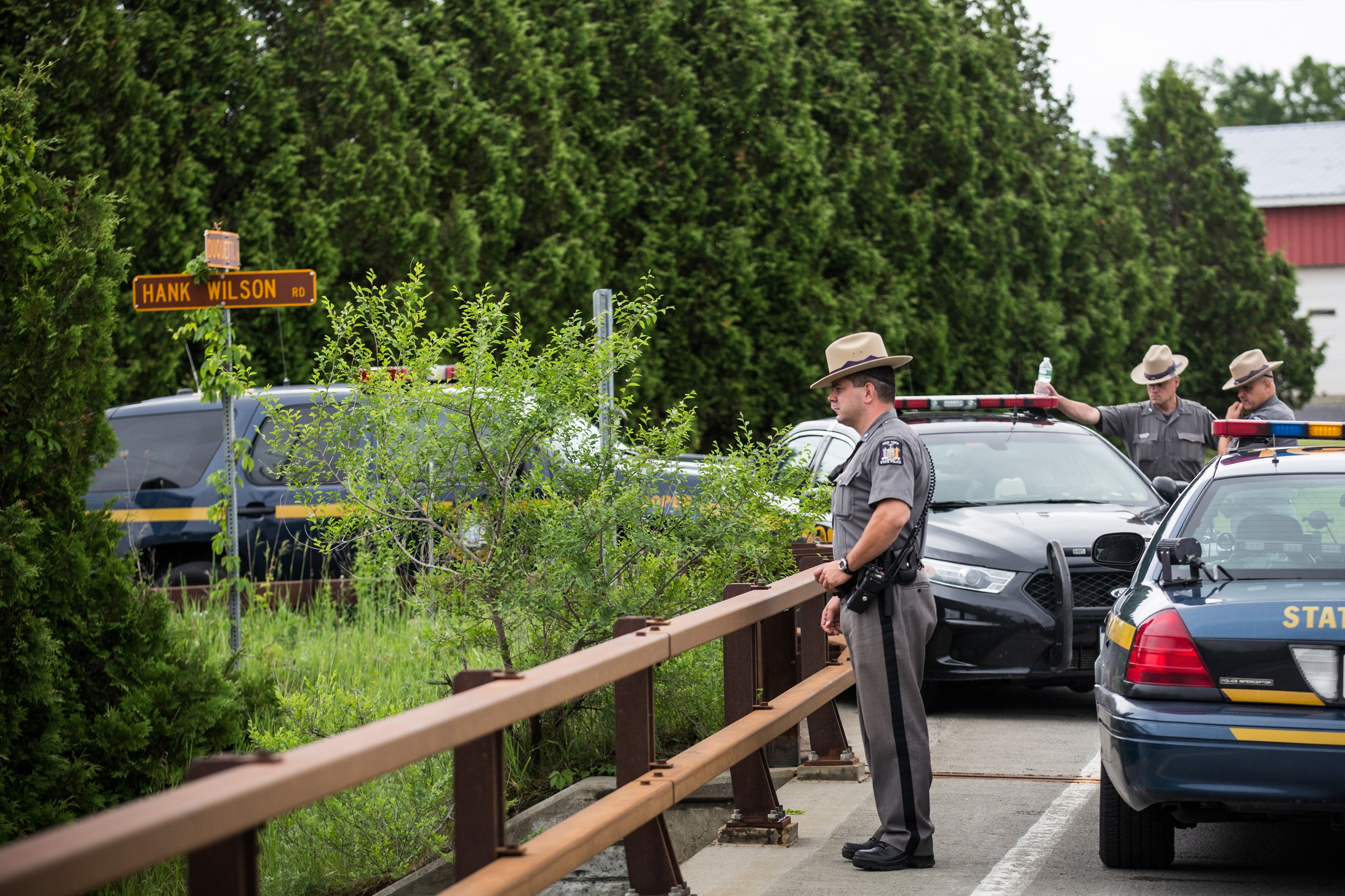 New York State troopers hold a meeting while searching for two escaped convicts June 15 outside Dannemora.