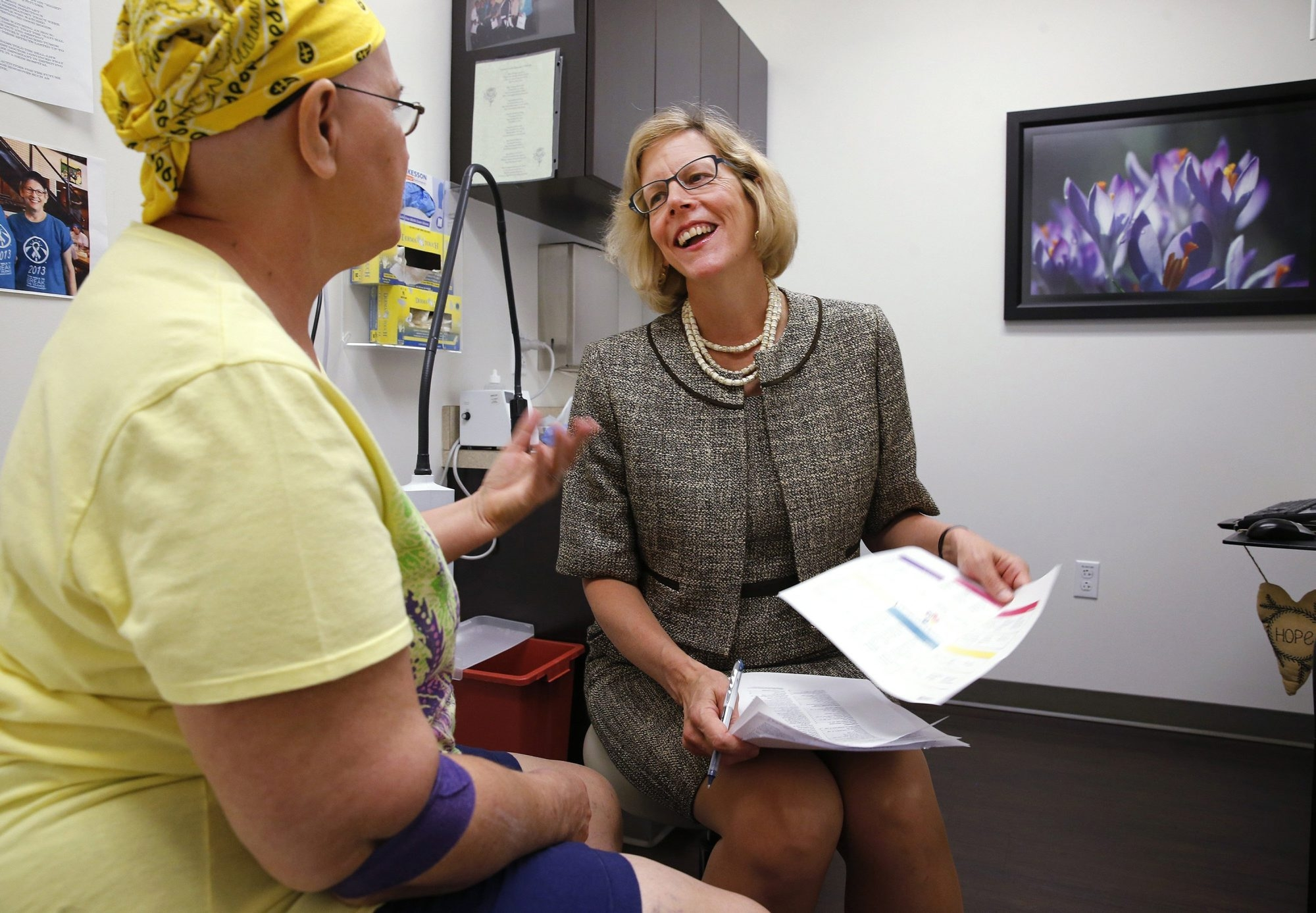 Dr. Carolyn Matthews, a gynecological oncologist, right, talks to patient Leslie John about her cancer in her office at the Baylor Charles A. Sammons Cancer Center in Dallas on Tuesday, Sept. 30, 2014. (David Woo/Dallas Morning News/MCT)
