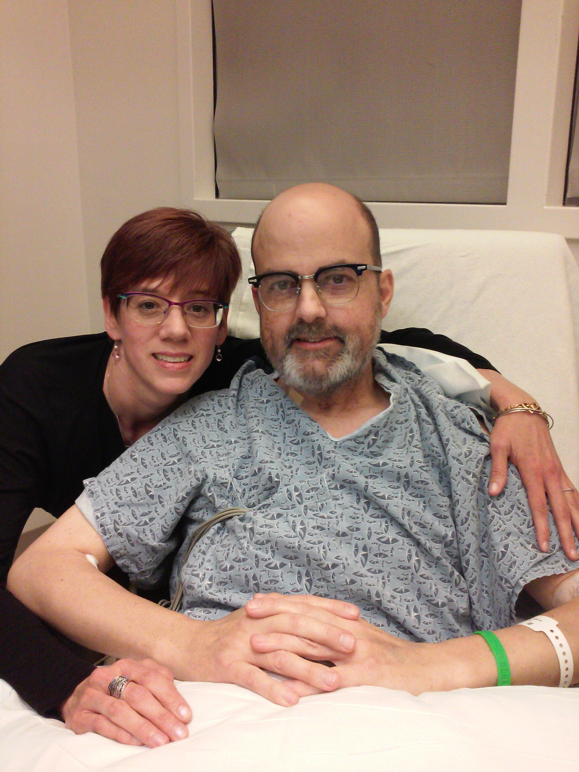 Sherry Brinser-Day visits with her husband, Tim, after his May 31 heart transplant. The Town of Tonawanda police officer's heart had been ravaged by an autoimmune disease.