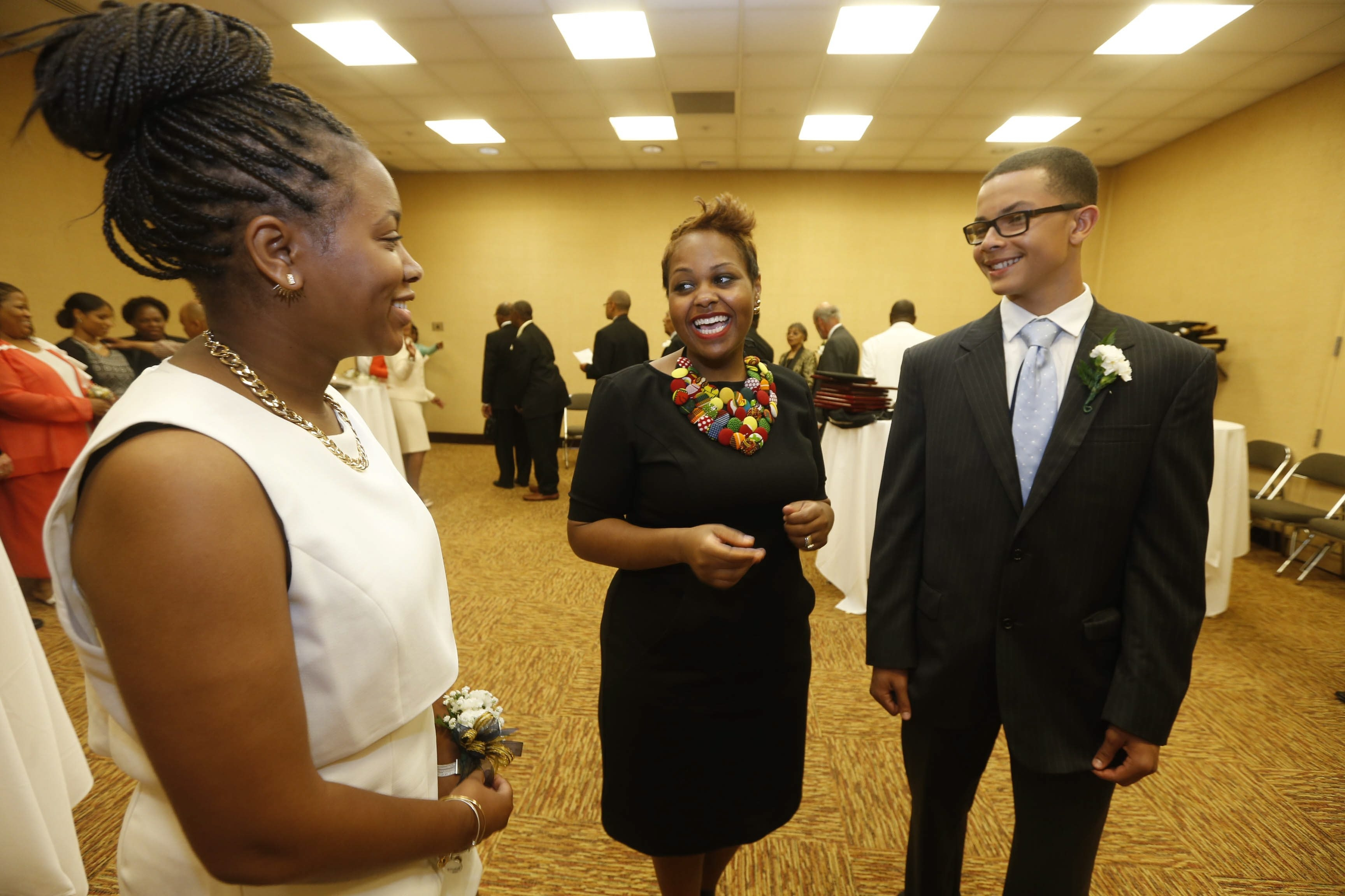 Keynote speaker Carmen Berkley, director for the Civil, Human and Women's Rights Department of the AFL-CIO, center, speaks with 2015 youth awardees Alana Leveritte, left, and Brandon Barksdale before the NAACP Buffalo dinner at the Buffalo Niagara Convention Center  Sunday, June 14, 2015.  (Robert Kirkham/Buffalo News)