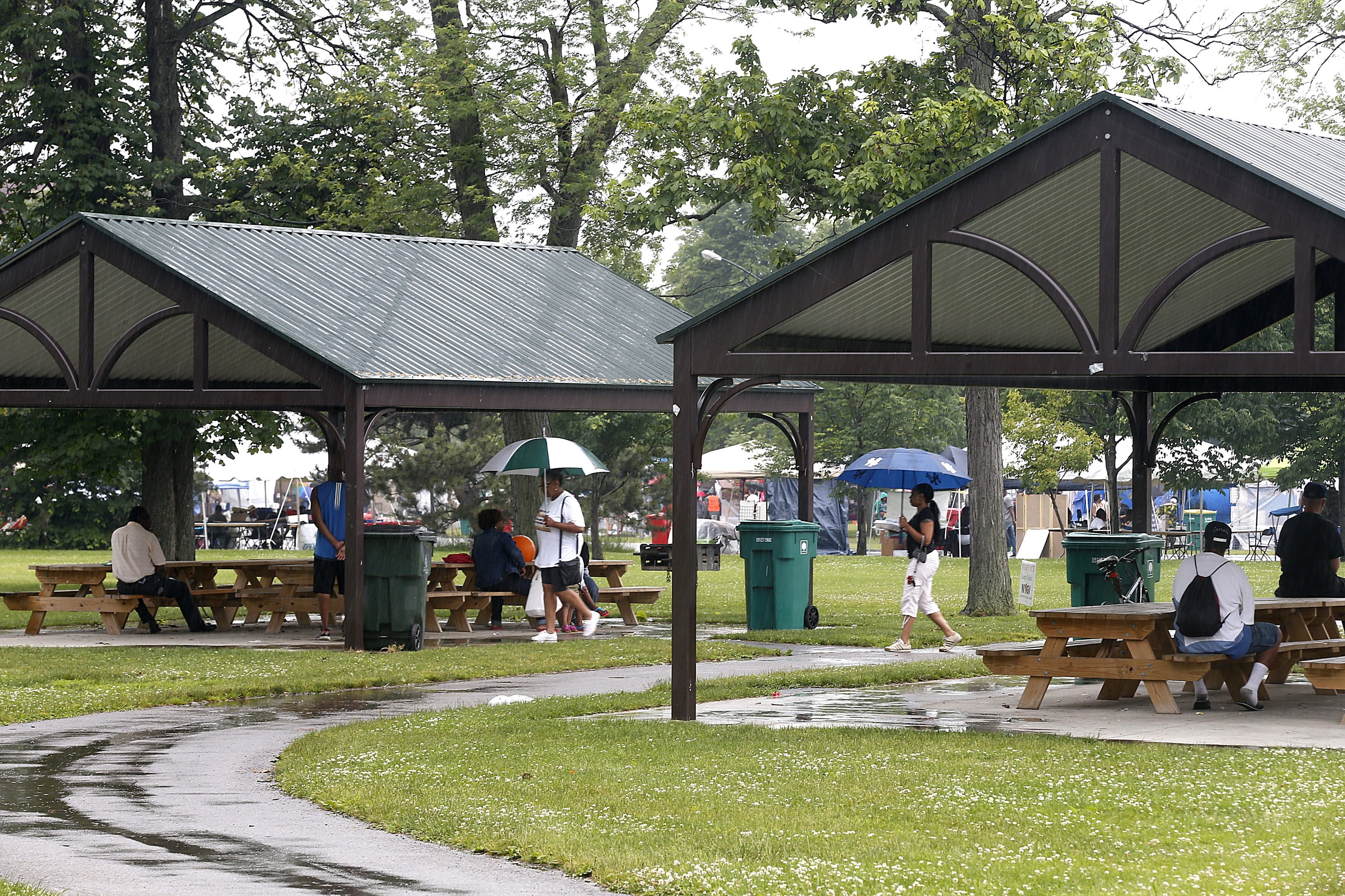 New shelters at MLK Jr. Park come in handy during a rainy Juneteenth Festival. The shelters were part of a $2.7 million upgrade to the park, which included a playground. $200,000 basketball courts were also added, and were christened by the Girls Sports Foundation.