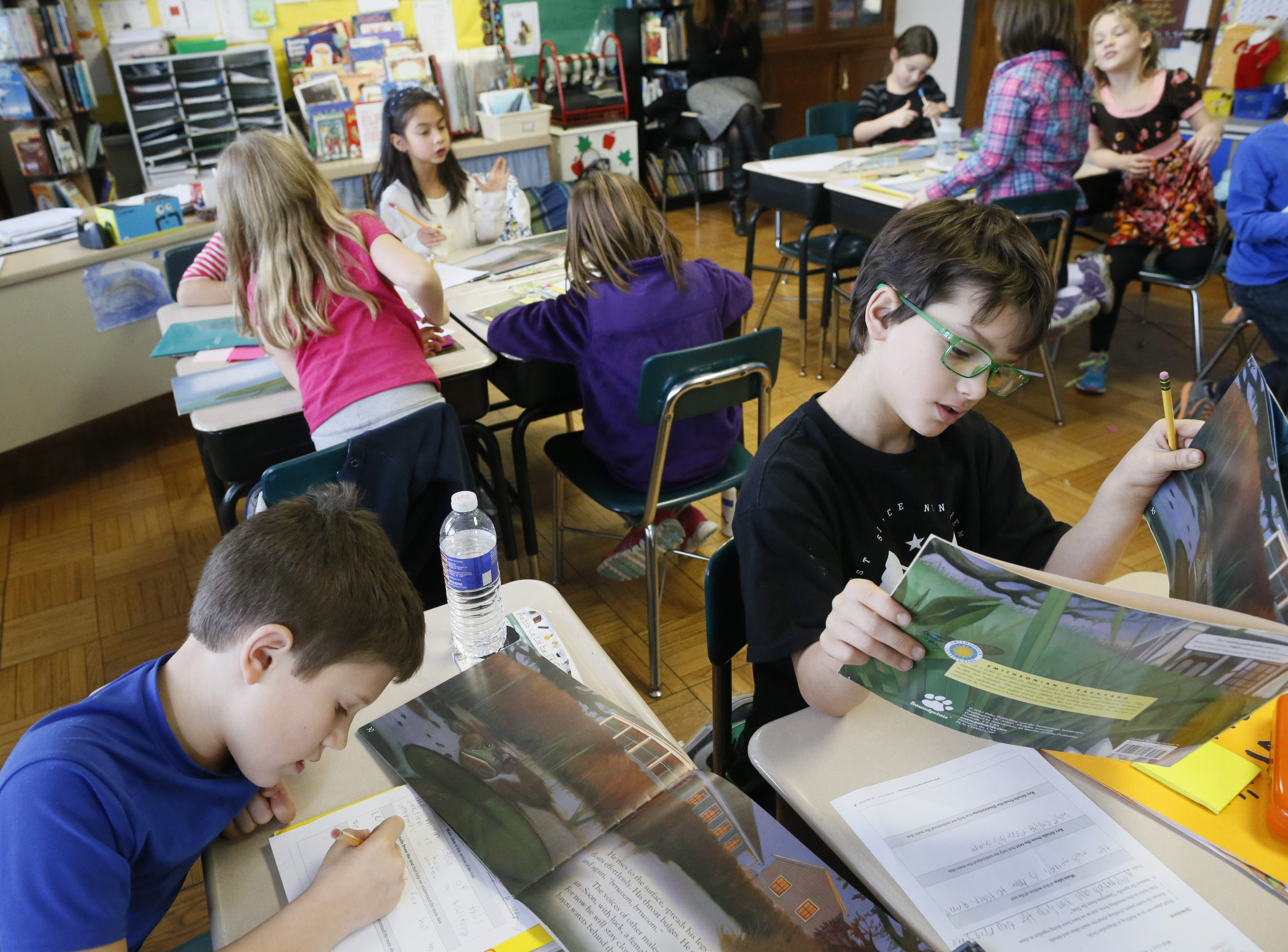 Third graders work on a close-reading exercise in Tiffany Kwas' class at Eden Elementary School as Common Core standards set higher goals for students. (Derek Gee/Buffalo News file photo)