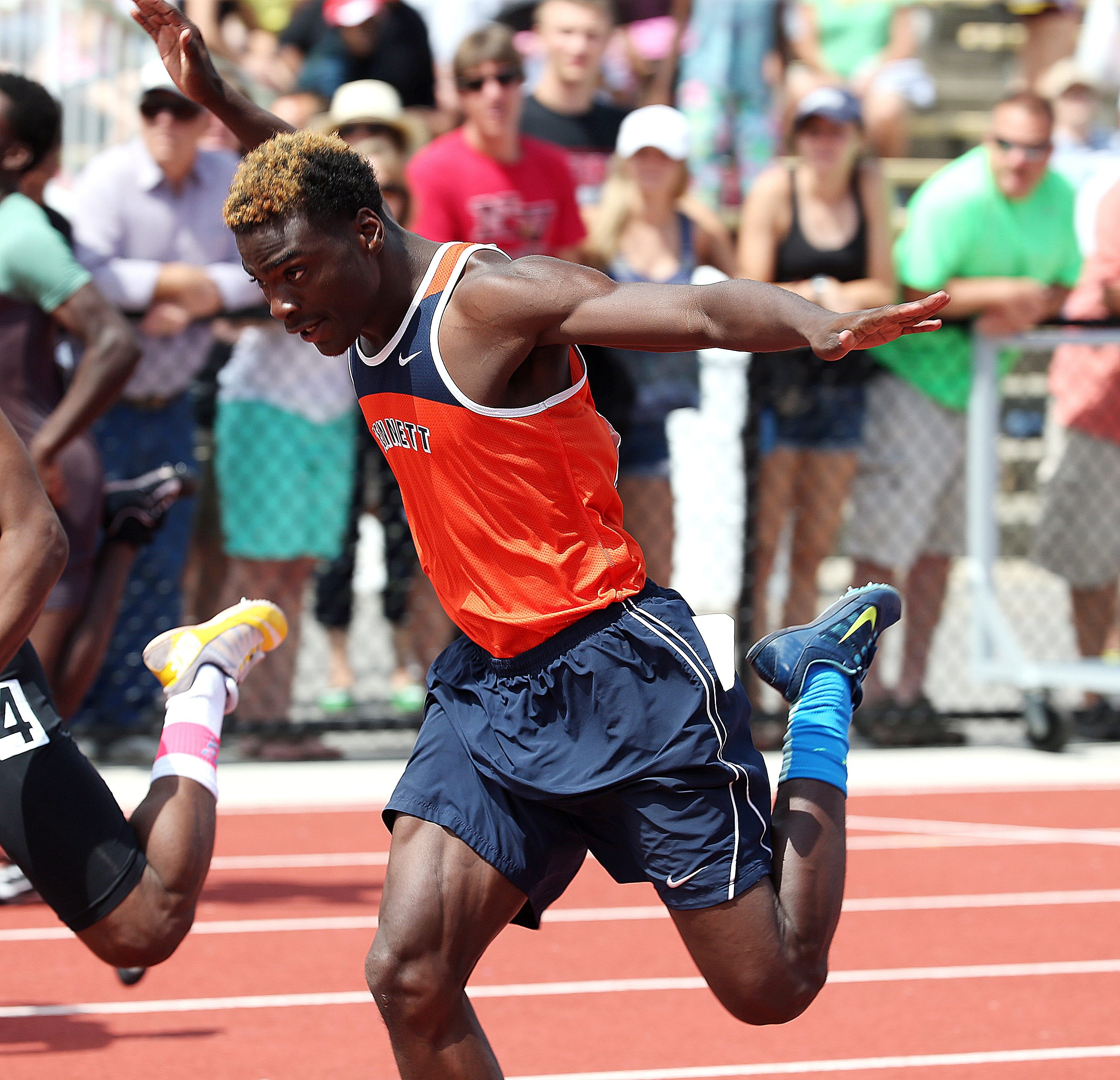 Bennett's Alex Dildy competes in the boys 100 meter dash, finishing at 11.02 seconds.