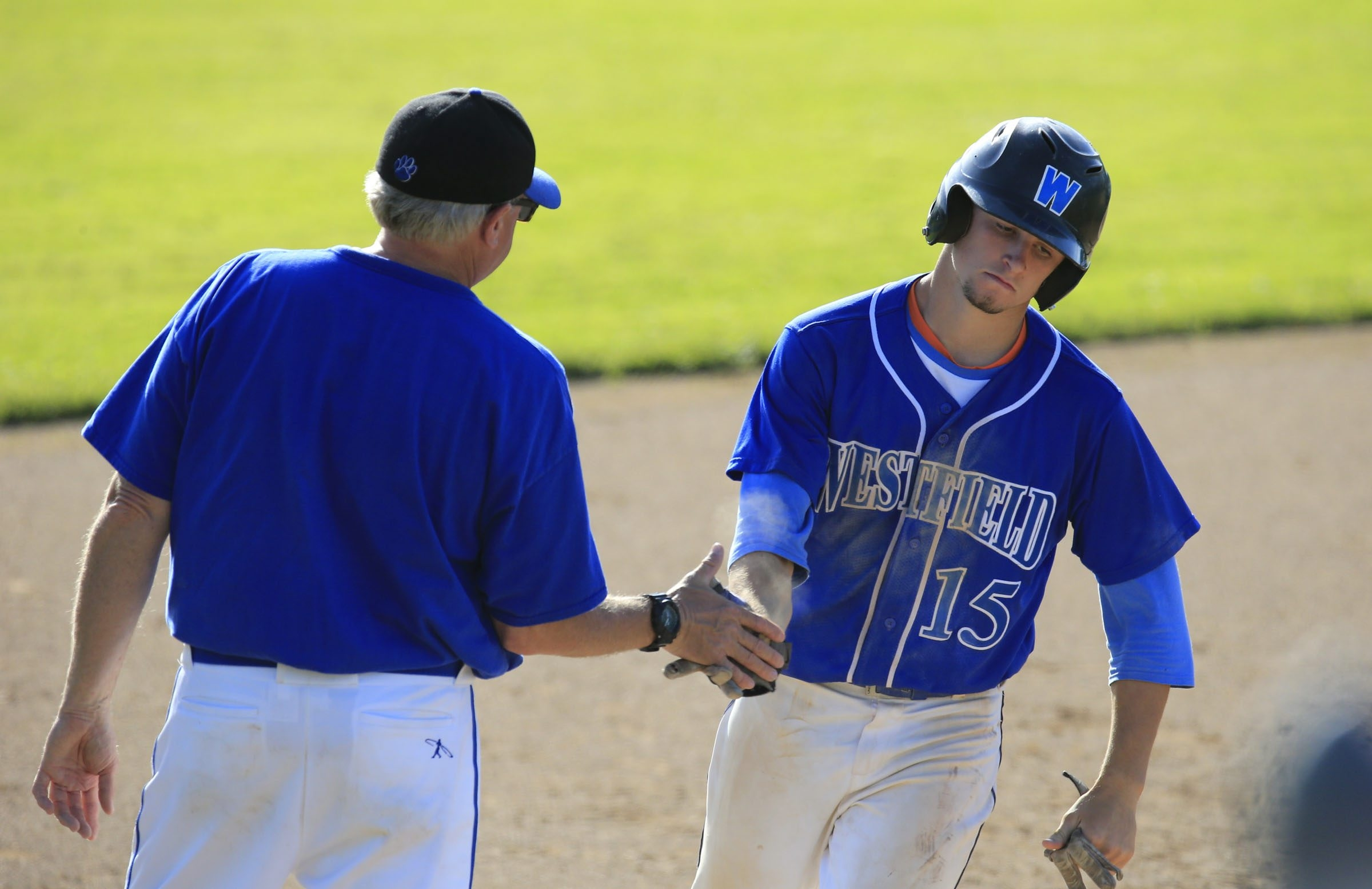 Westfield's Nolan Hunt is congratulated by coach Doug Kaltenbach after hitting a seventh-inning home run in the Class D playoff.