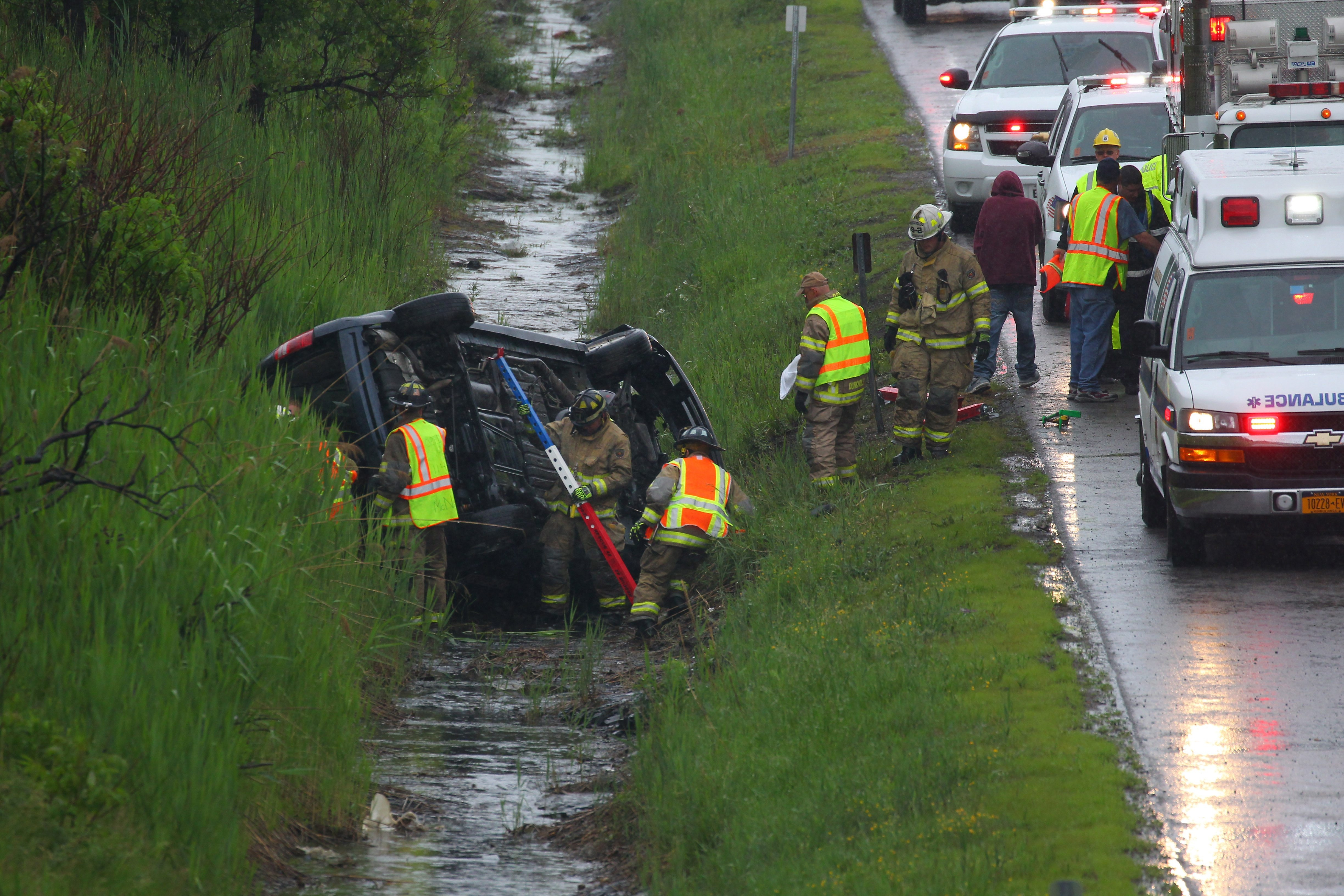 First responders work on the scene of a roll-over accident on Rte 219 in Orchard Park Tuesday, June 9, 2015.    (Mark Mulville/Buffalo News)