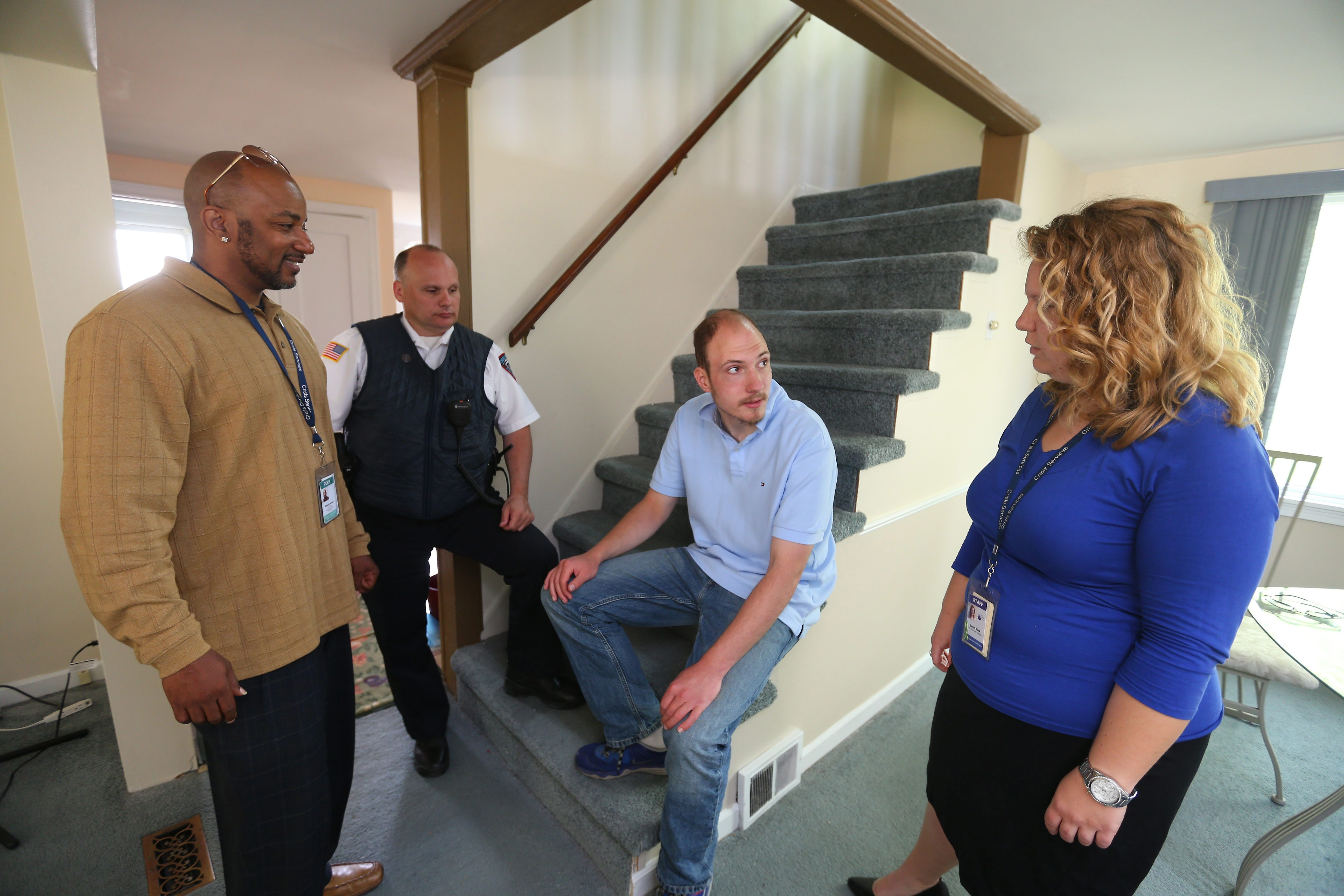 Erie County Crisis Services counselors Gerard Lawson, left, and Sarah Bonk talk with patient Shawn Offhaus in a visit to his home in Cheektowaga with Police Officer Anthony Filipski. The town's department is among those using crisis intervention team model.