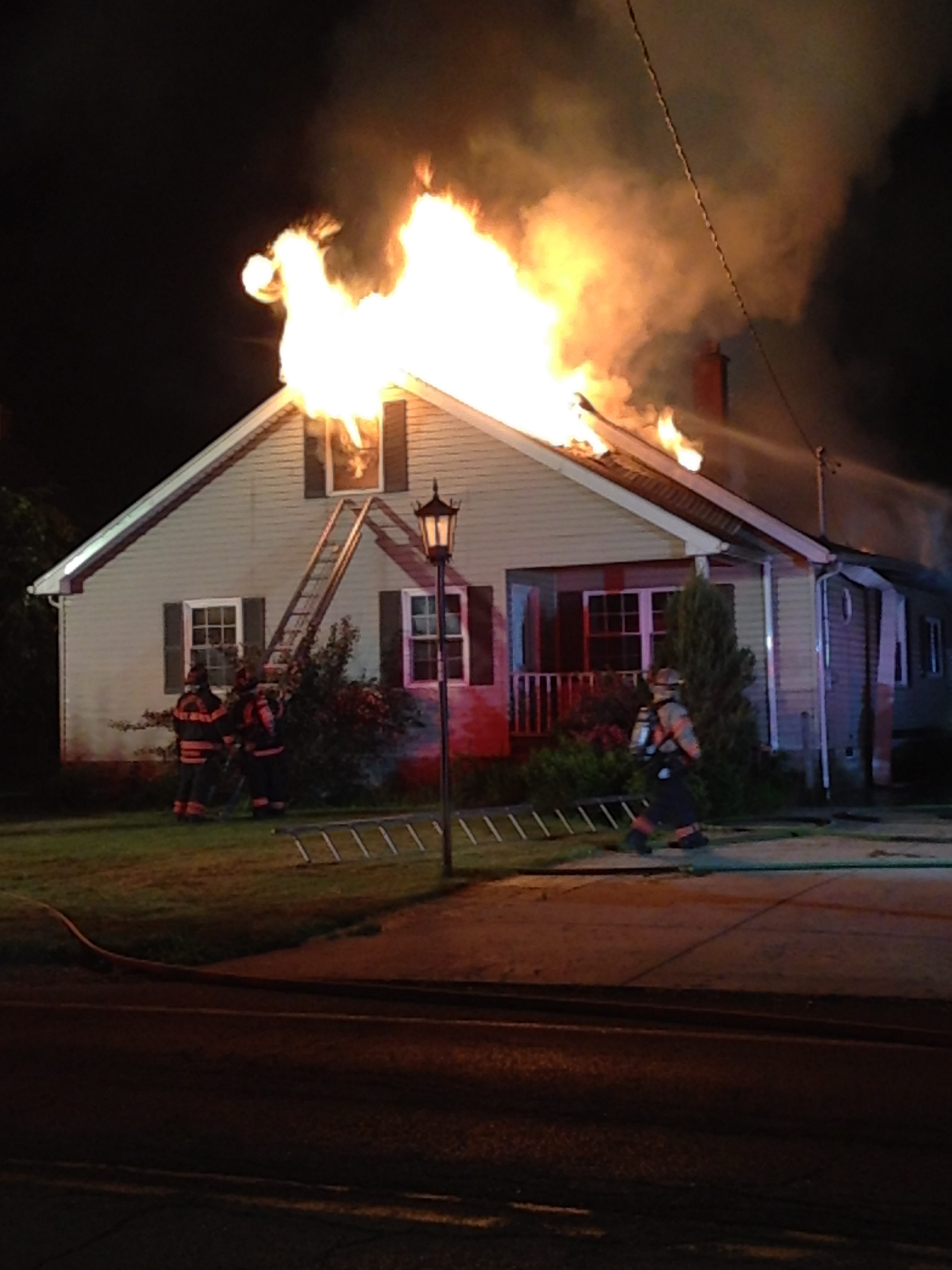 Snyder firefighters flight flames at the front of the house at 400 Park Club Lane Sunday, June 7, 2015. All occupants escaped safely when the fire broke out about 4 a.m. The Eggertsville Hose Company assisted. (John Neville/Buffalo News)