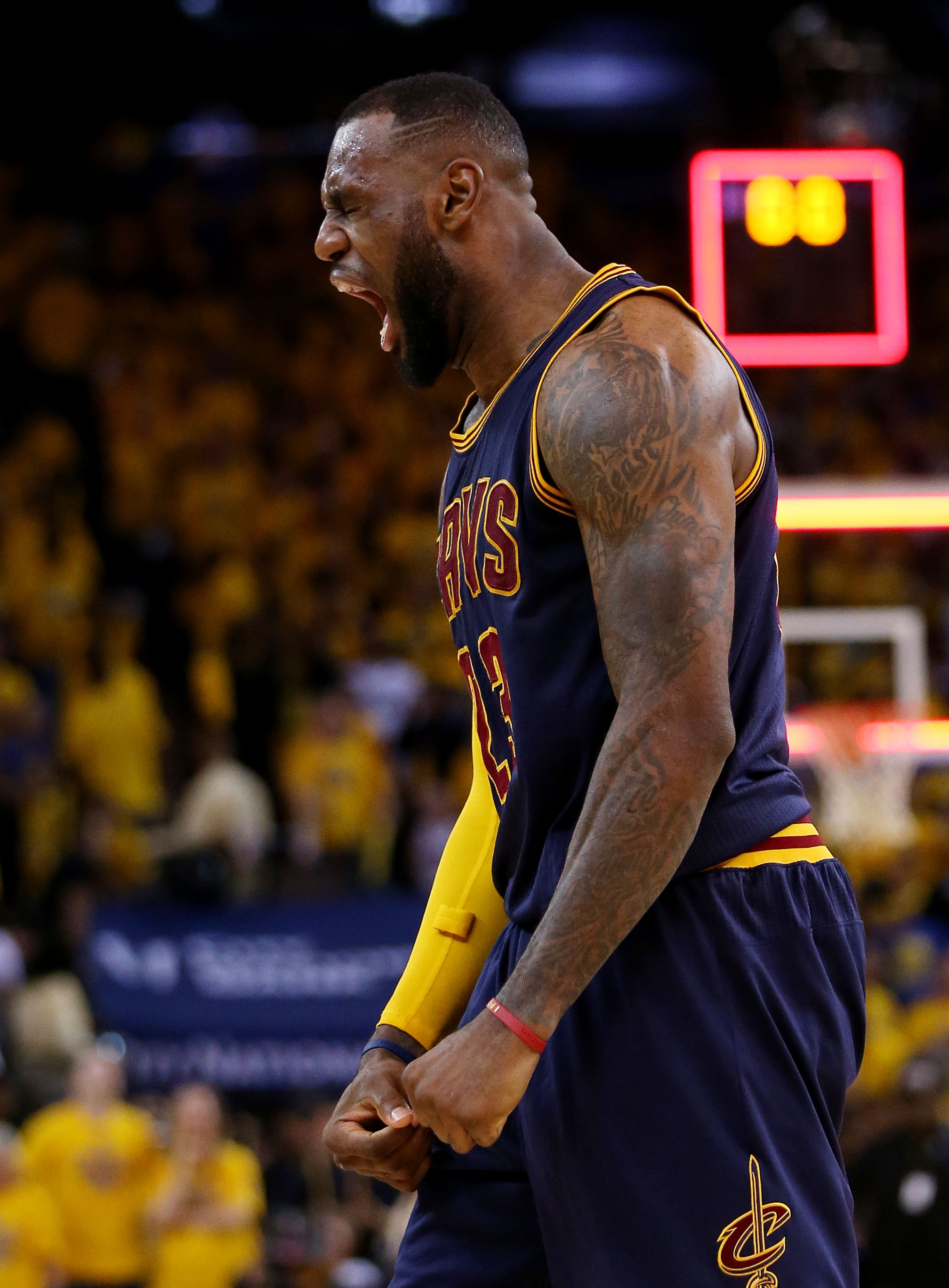 LeBron James of the Cavaliers celebrates his team's victory over the Warriors on Sunday night. The win evened the best-of-seven series at a game each.