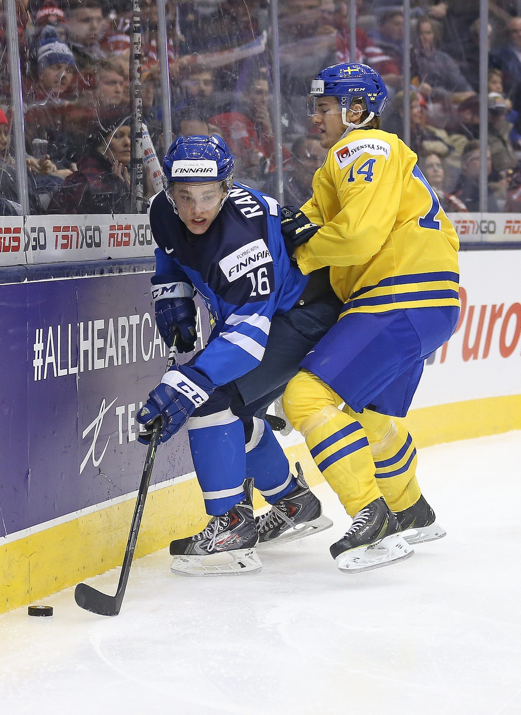 Mikko Rantanen of Finland, right, can use his size to his advantage as well as create offensive chances.