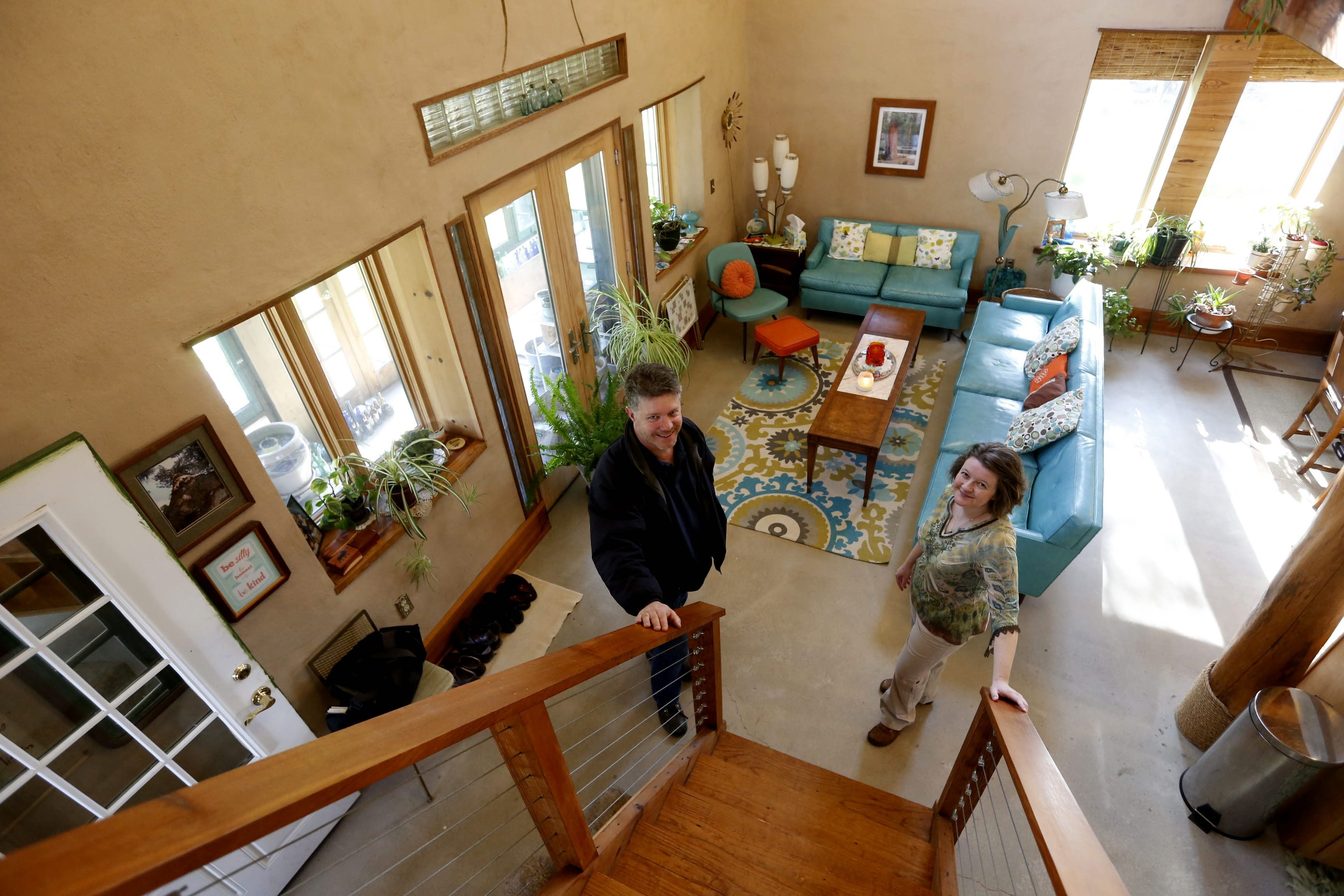 Builder David Lanfear and Carrie Zaenglein in Carrie Zaenglein's straw bale home in Depew on Tuesday, April 28, 2015.  (Robert Kirkham/Buffalo News)