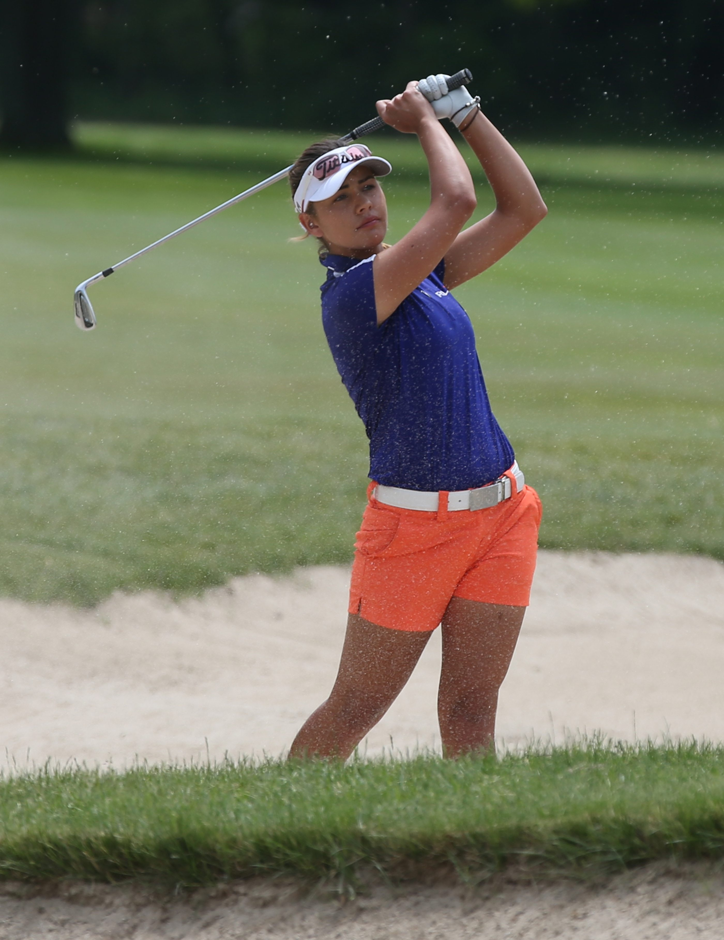 Ana Paula Valdes hits out of the sand during Friday's final round of the Women's Porter Cup at Niagara Falls Country Club.