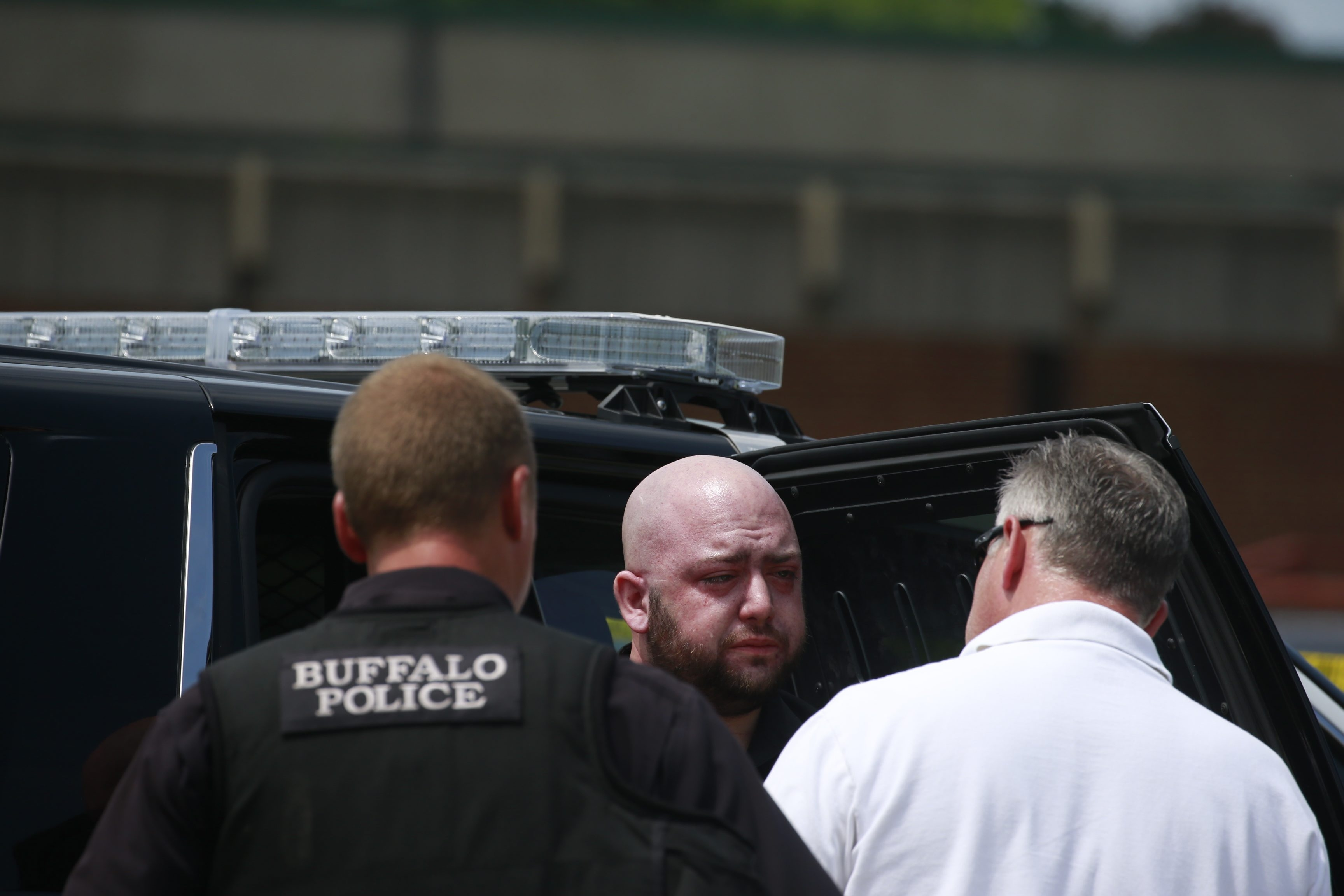 Buffalo Police question Christian P. Myers in Delaware Park shortly after his car struck three pedestrians on Saturday.