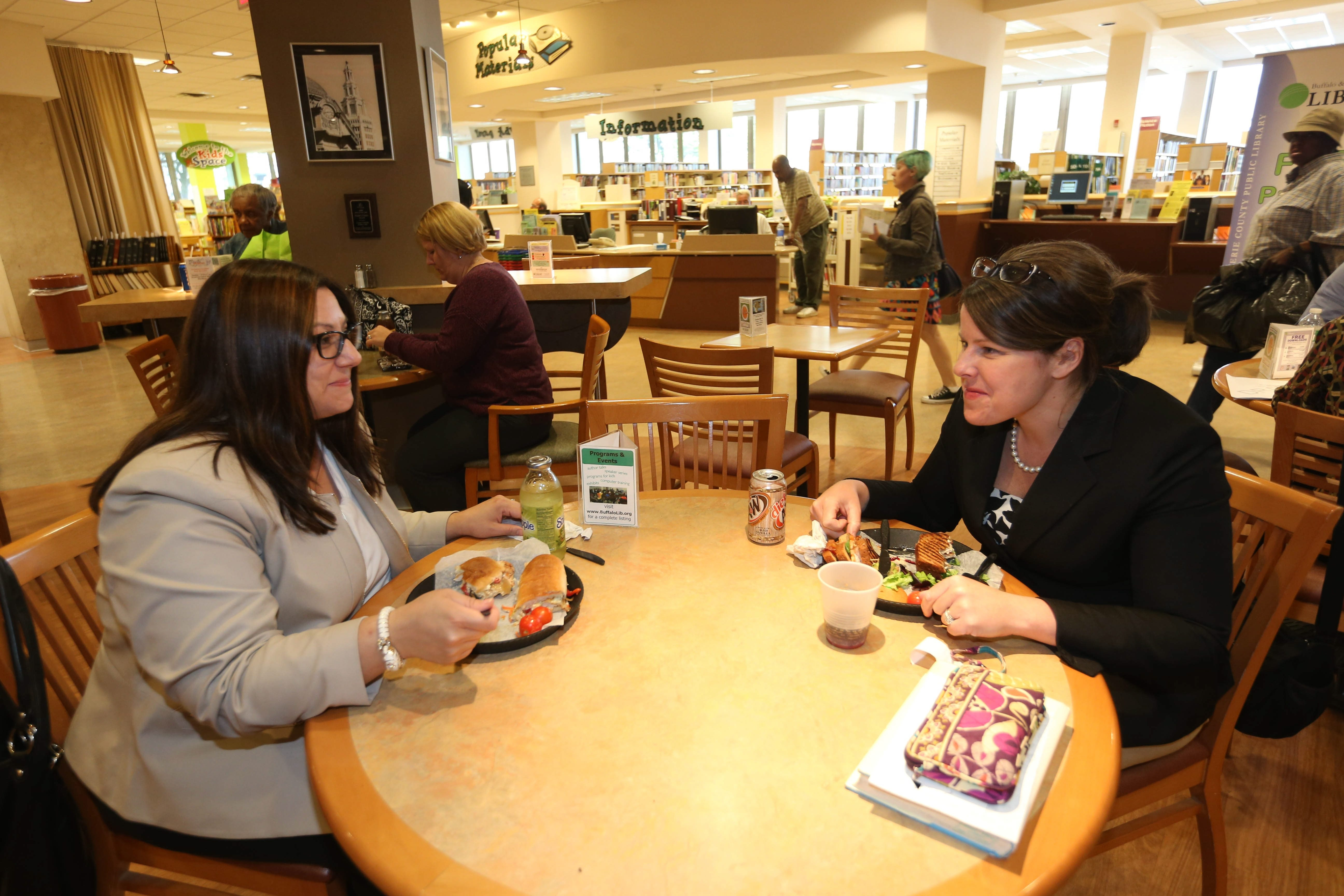 Dana Mis, left, and Heather Becker have lunch at Fables Cafe, a spacious eating area inside the Central Library, Lafayette Square. To see more photos, visit buffalonews.com.