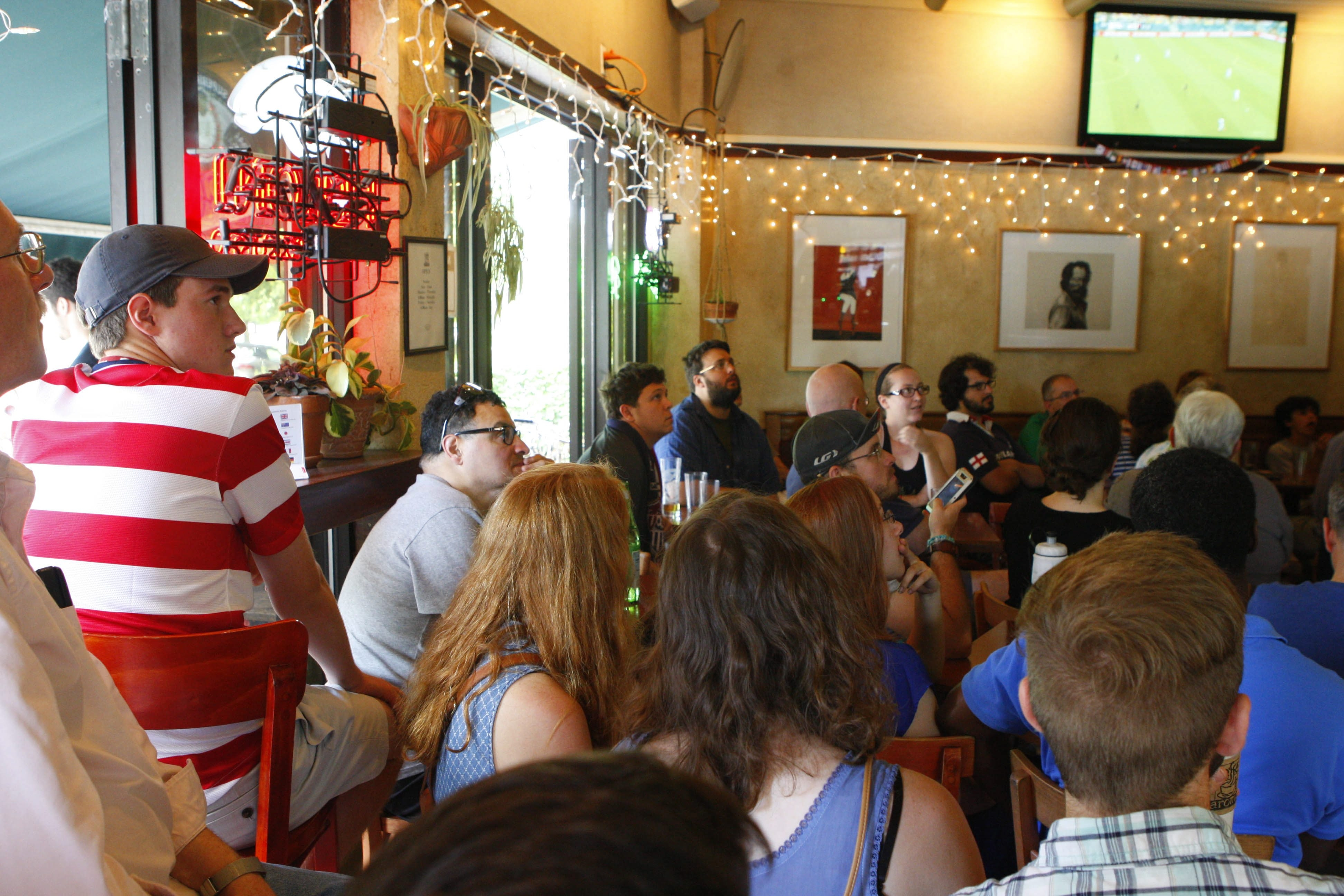 Fans watch the USA vs. Germany World Cup match at Cafe Aroma on Bidwell and Elmwood, Thursday, June 26, 2014.  (Derek Gee/Buffalo News)