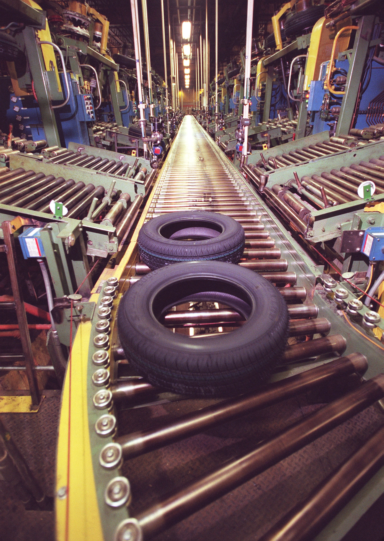 BY WIPPERT   5/17/00  TIRES NEAR THE END OF THEIR JOURNEY HEADING TOWARDS FINAL INSPECTION