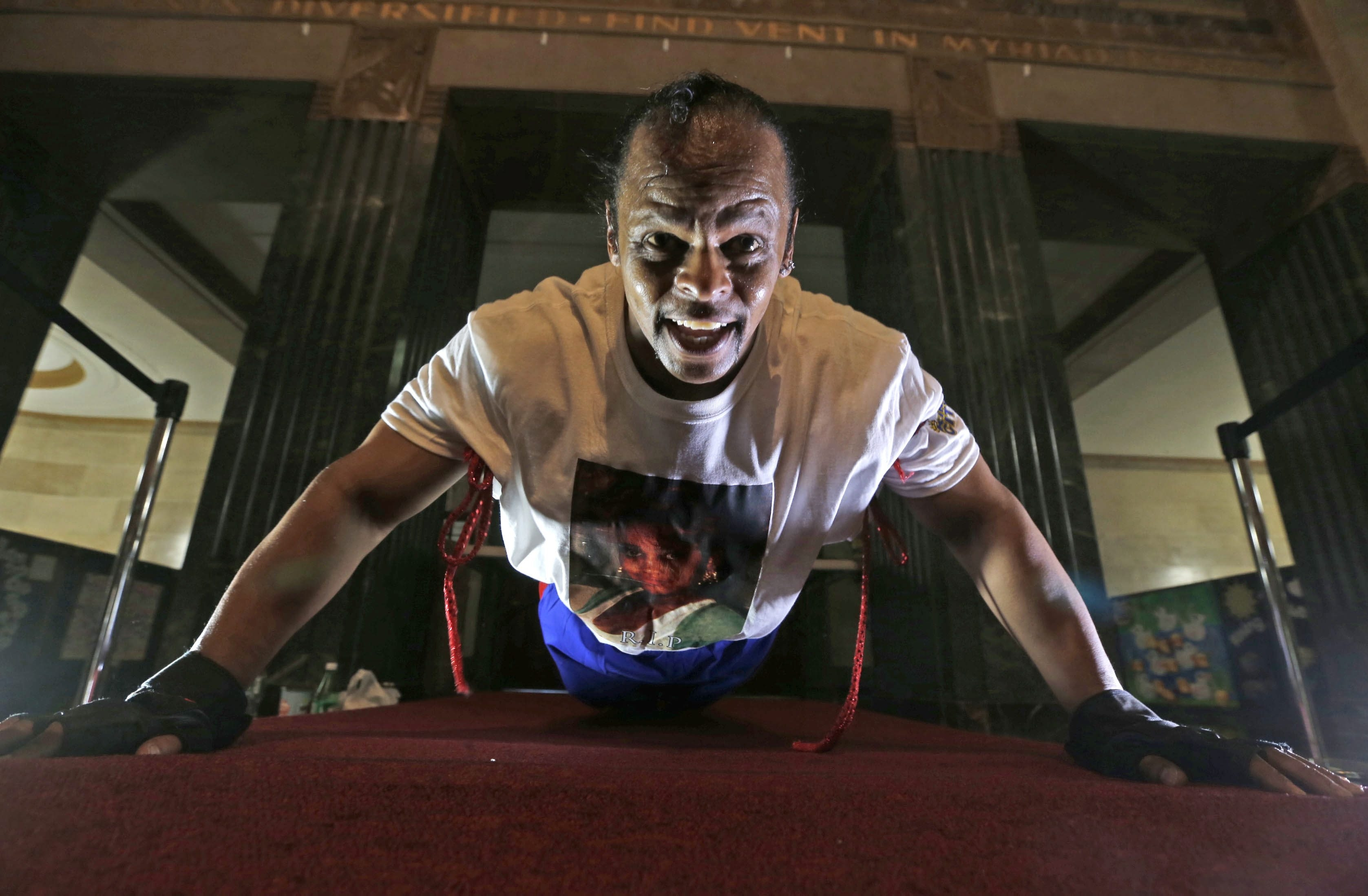 Buffalo's Jeff Warrick was doing push-ups in the lobby of City Hall Thursday in hopes of winning a Guinness World record. Record is now 46,0001 in 24 hours.