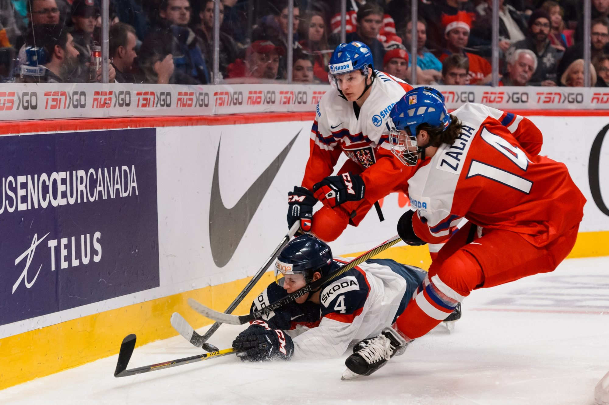 MONTREAL, QC - JANUARY 02:  Pavel Zacha #14 of Team Czech Republic takes down Mislav Rosandic #4 of Team Slovakia while chasing the puck in a quarterfinal round during the 2015 IIHF World Junior Hockey Championships at the Bell Centre on January 2, 2015 in Montreal, Quebec, Canada.  (Photo by Minas Panagiotakis/Getty Images)