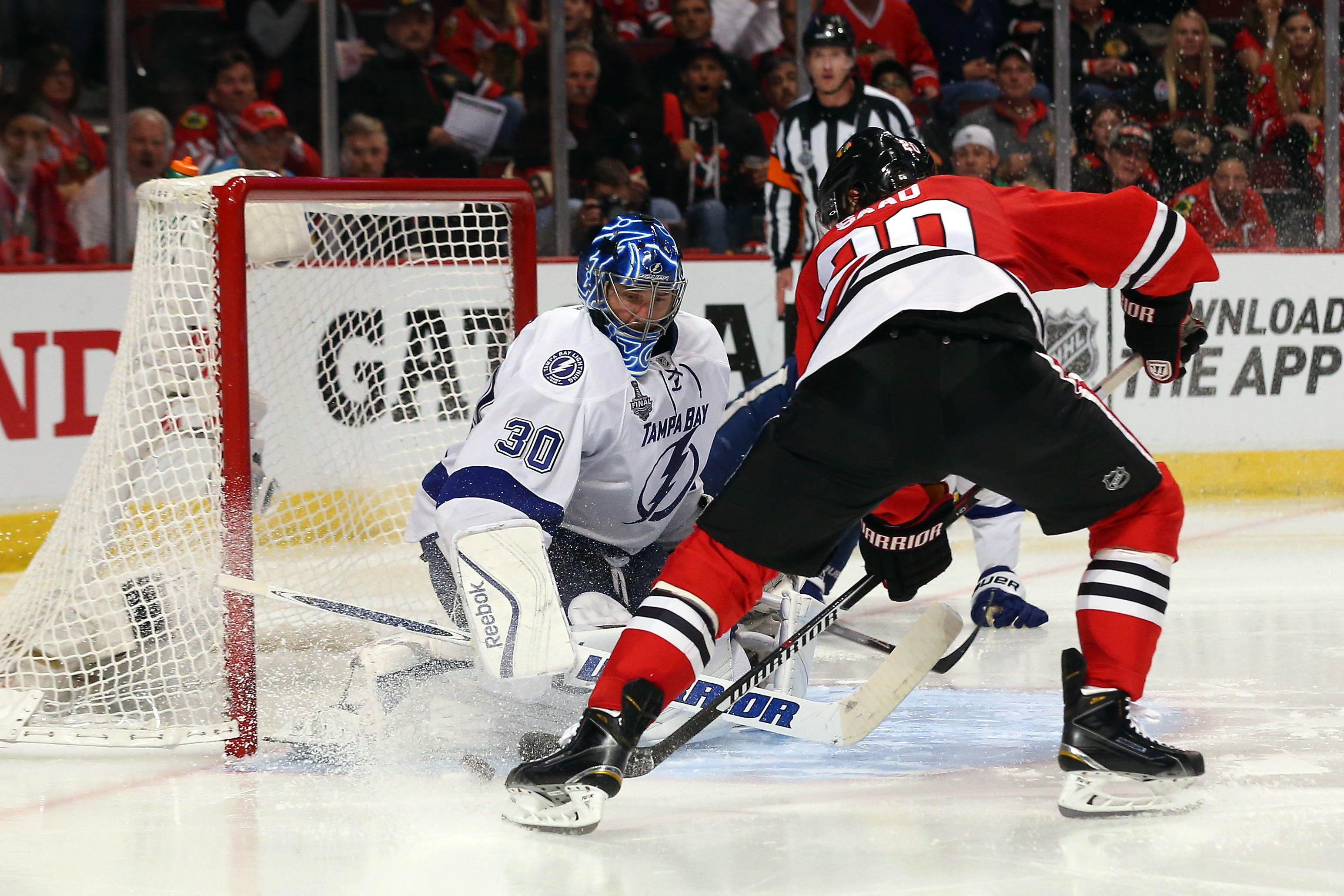 Tampa Bay Lightning goalie Ben Bishop denies Chicago's Brandon Saad for one of his 36 saves during Game Three of the Stanley Cup final at the United Center.