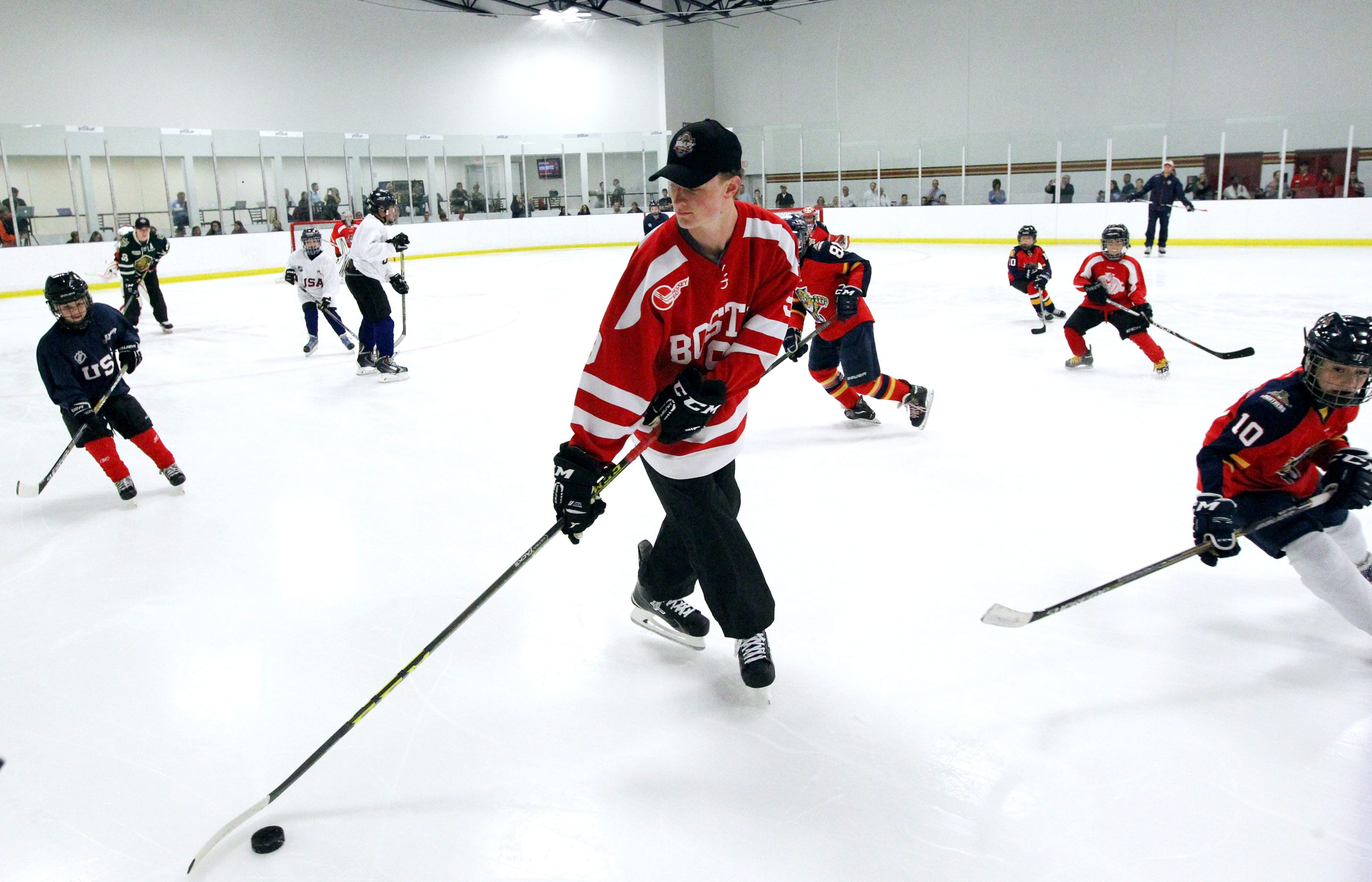 Jack Eichel skates with the kids at the NHLTop Prospects Clinic in Coral Springs, Fla., on Thursday.