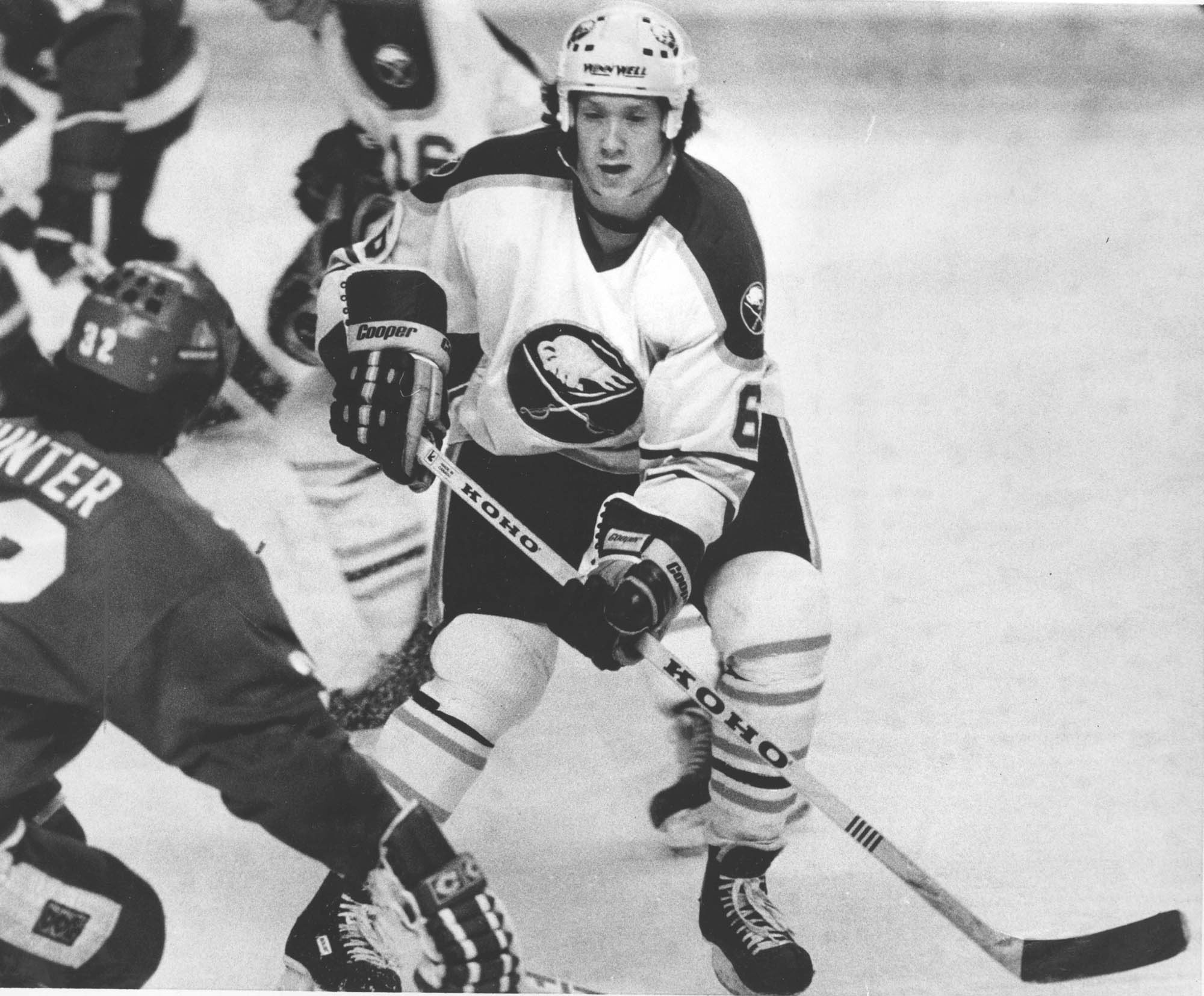 Phil Housley was drafted in the first round by then-General Manager Scotty Bowman in 1982 but was traded eight years later to Winnipeg.
